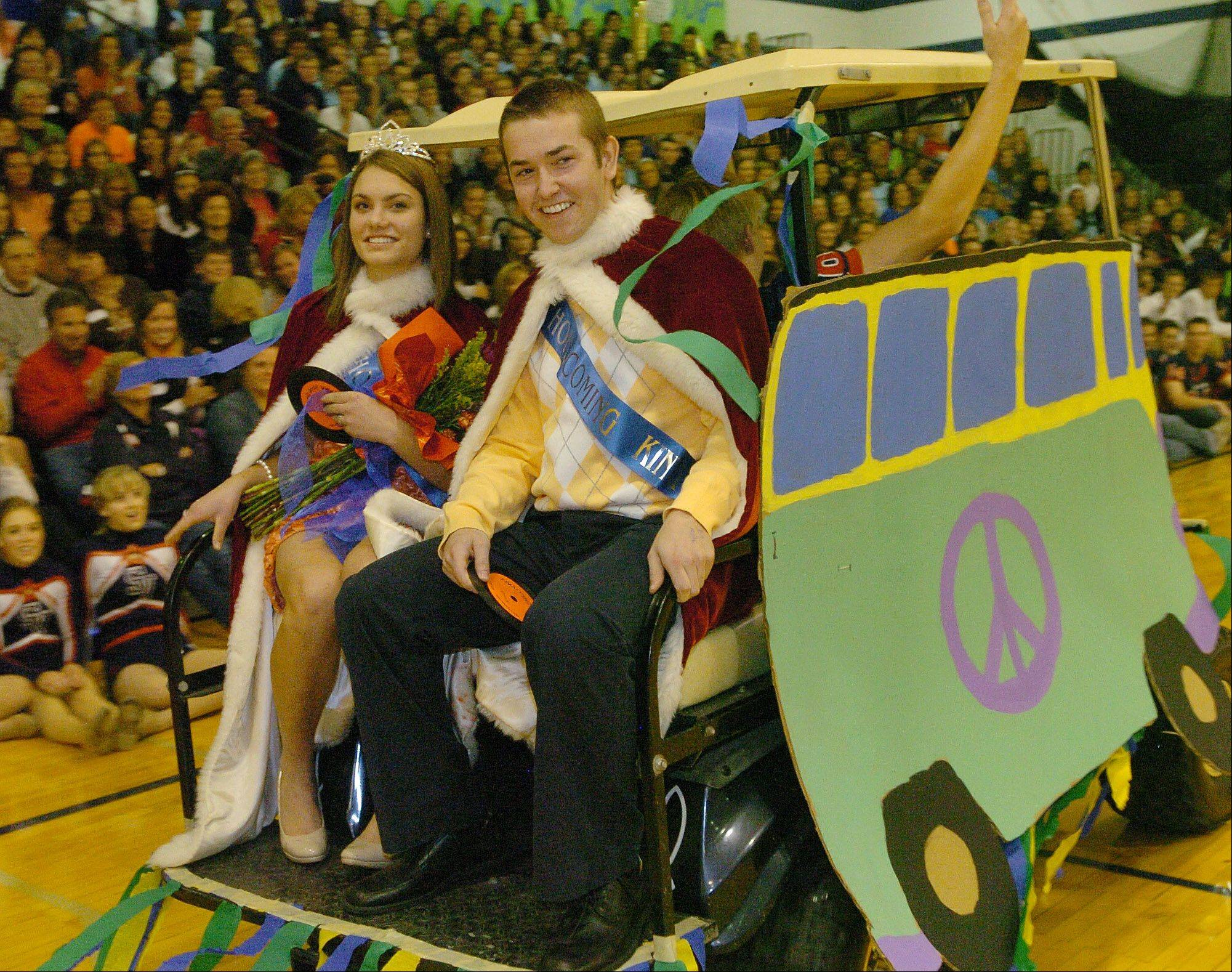 Emma Hogaboom and Tommy Sullivan get a ride around the gym after being crowned King and Queen during St. Viator's Homecoming Pep Rally.