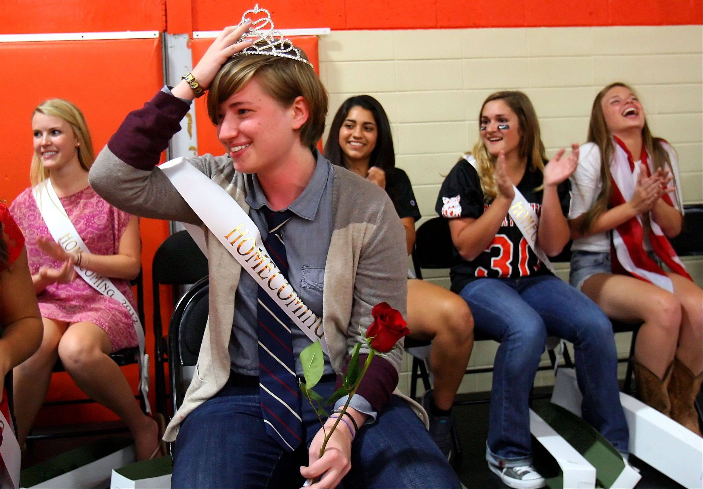 Libertyville High School senior Emily Gilbertsen reacts after receiving the homecoming queen crown.
