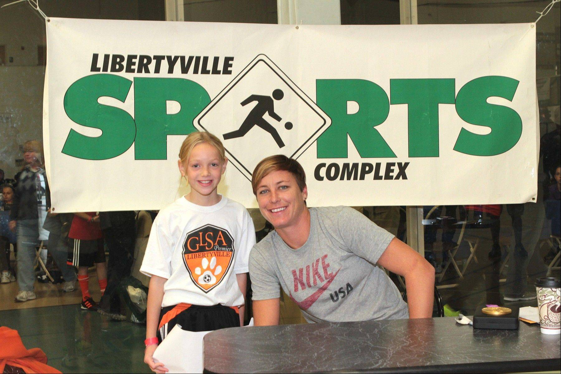 Team USA women's soccer star Abby Wambach poses with Libertyville youth soccer player Stella Bechtold during the IYSA Soccer for Success event at the Libertyville Sports Complex last Saturday.