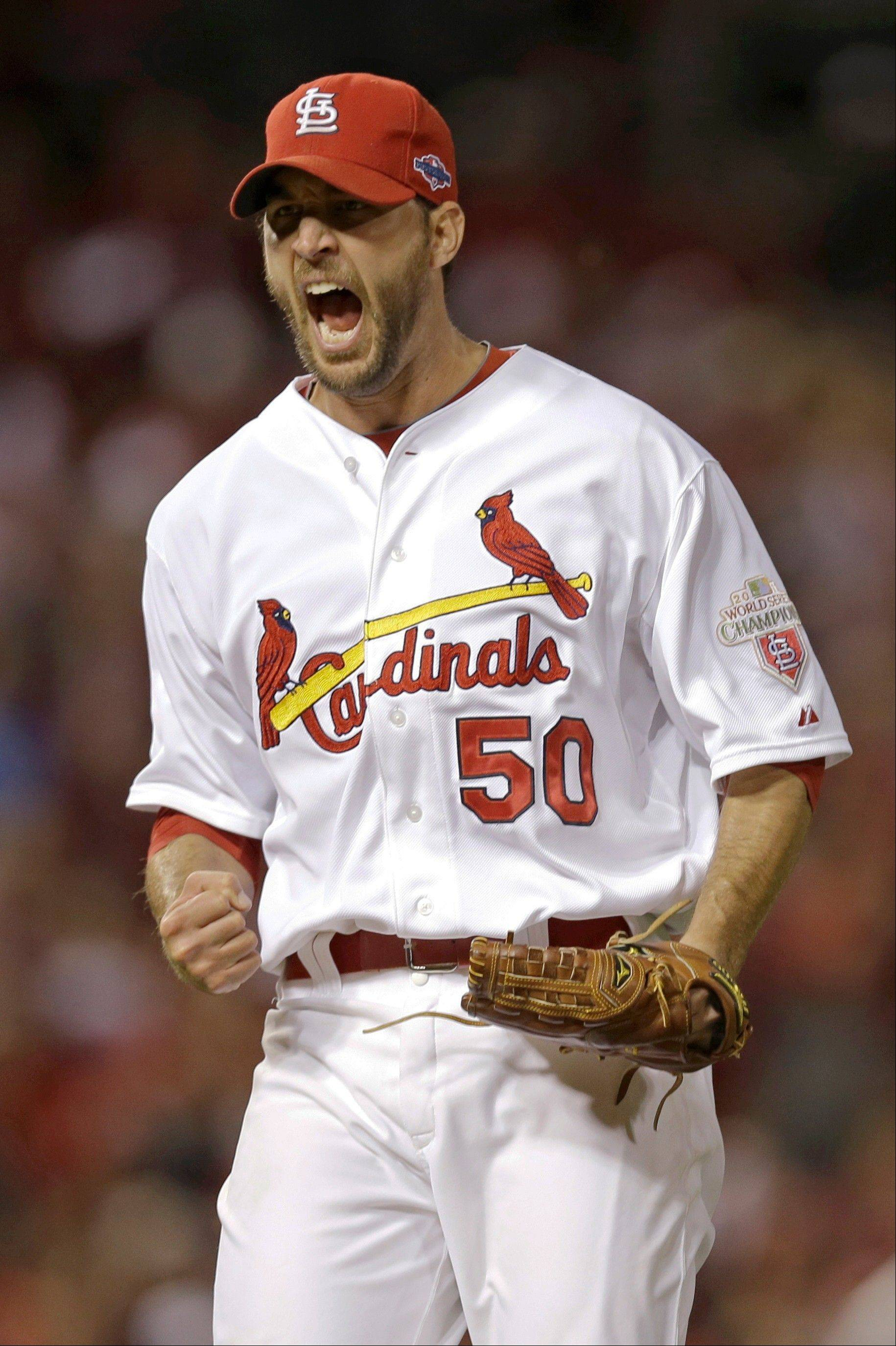 St. Louis Cardinals starting pitcher Adam Wainwright reacts after getting San Francisco Giants' Pablo Sandoval to ground out and end the sixth inning of Game 4 of baseball's National League championship series Thursday, Oct. 18, 2012, in St. Louis.