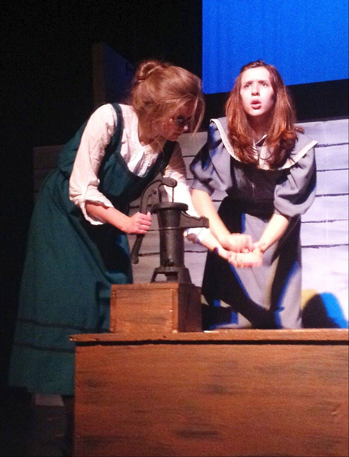 Regina Aiuppa of Itasca plays Helen Keller's mother. She appeals for compassion from her husband, Captain Keller, played by Ryan Lavelle of Hoffman Estates, as she cradles her daughter Helen, played by Natalie Olson of Prospect Heights.