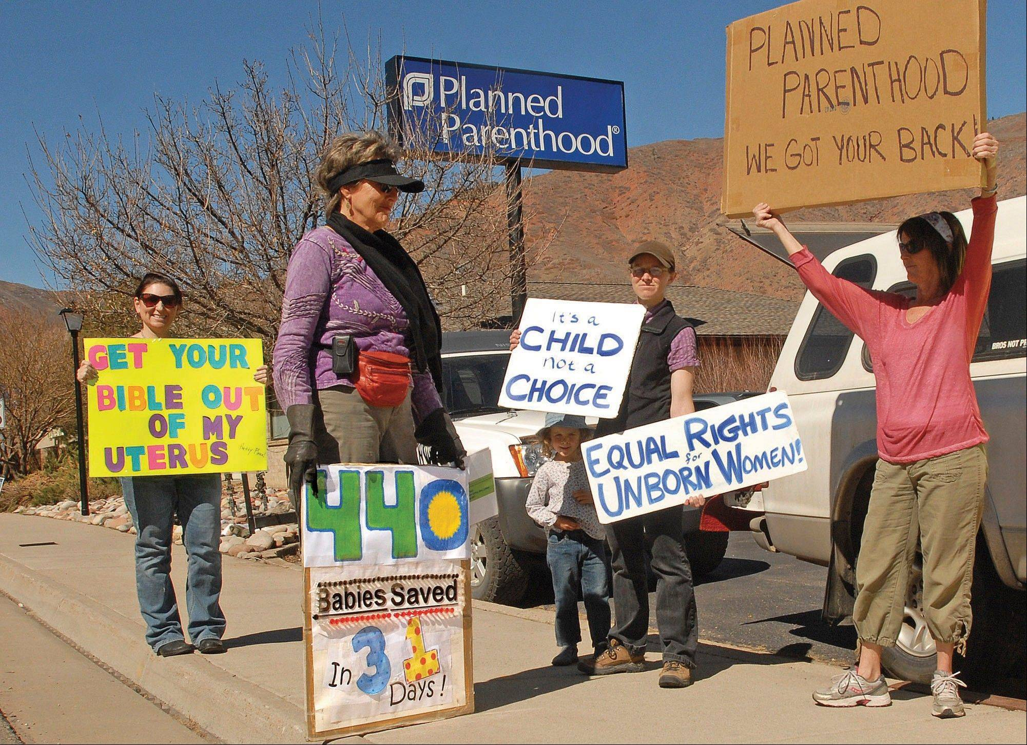 Supporters from both sides of the abortion issue share the sidewalk next to the Planned Parenthhood clinic in West Glenwood, Colo.