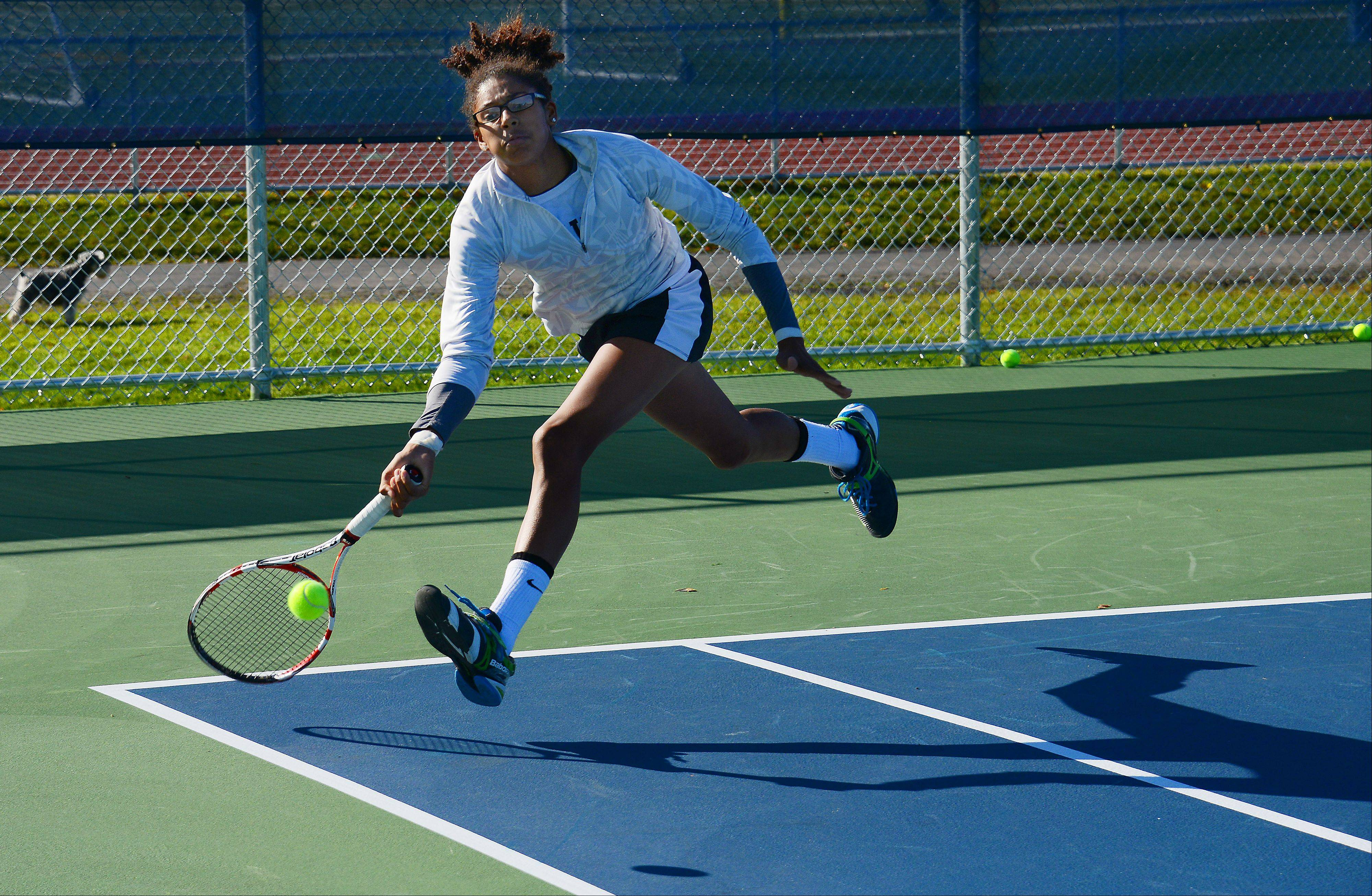 Wheaton Warrenville South�s Keisha Clousing returns a serve in the state girls tennis semifinals singles matchup against Brienne Minor of Carmel High School at Buffalo Grove High School on Saturday.