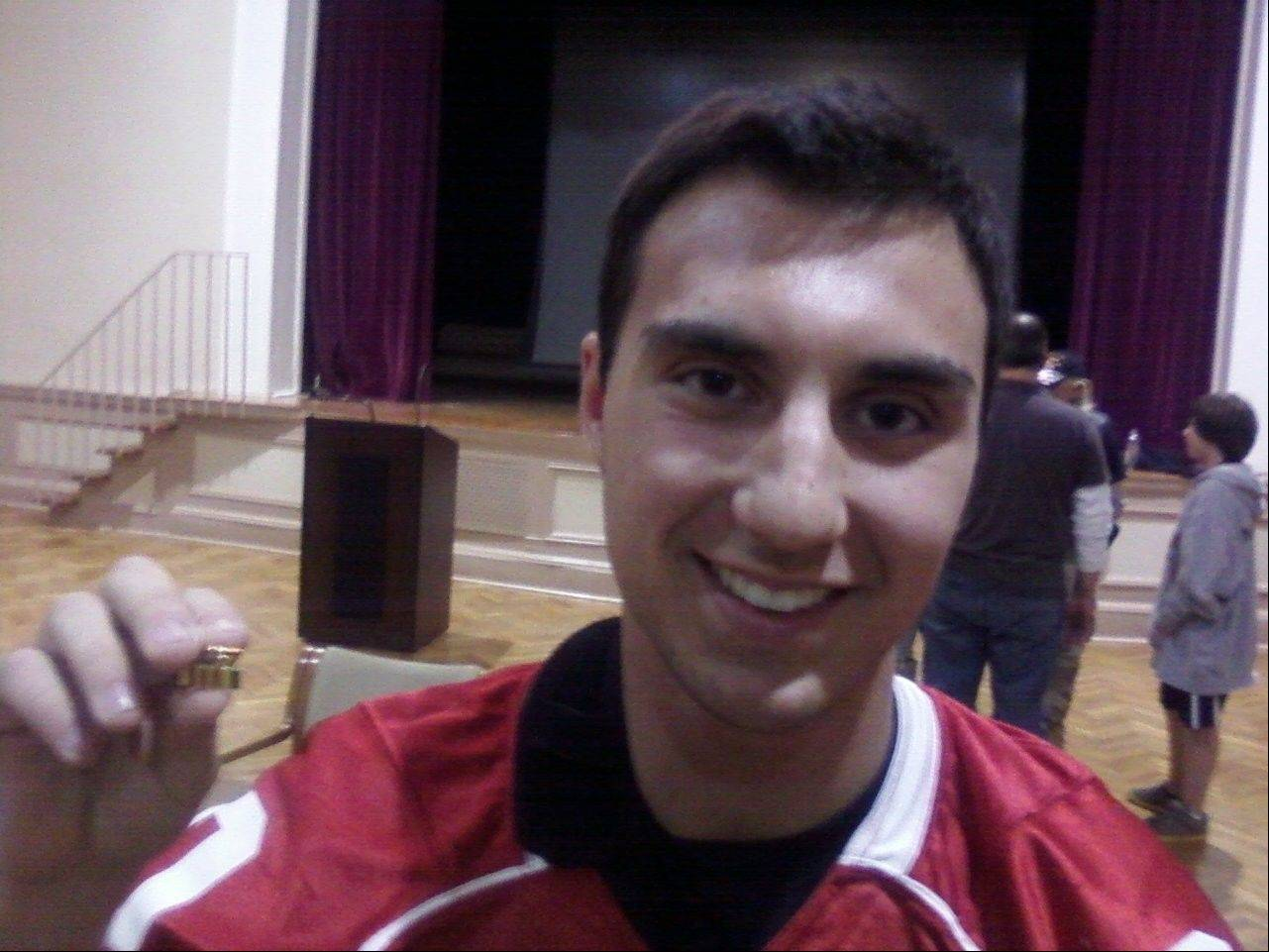 Mundelein senior linebacker Dominic Paliani shows off a pin he received from a Vietnam veteran at the Captain James A. Lovell Federal Health Care Center in North Chicago.