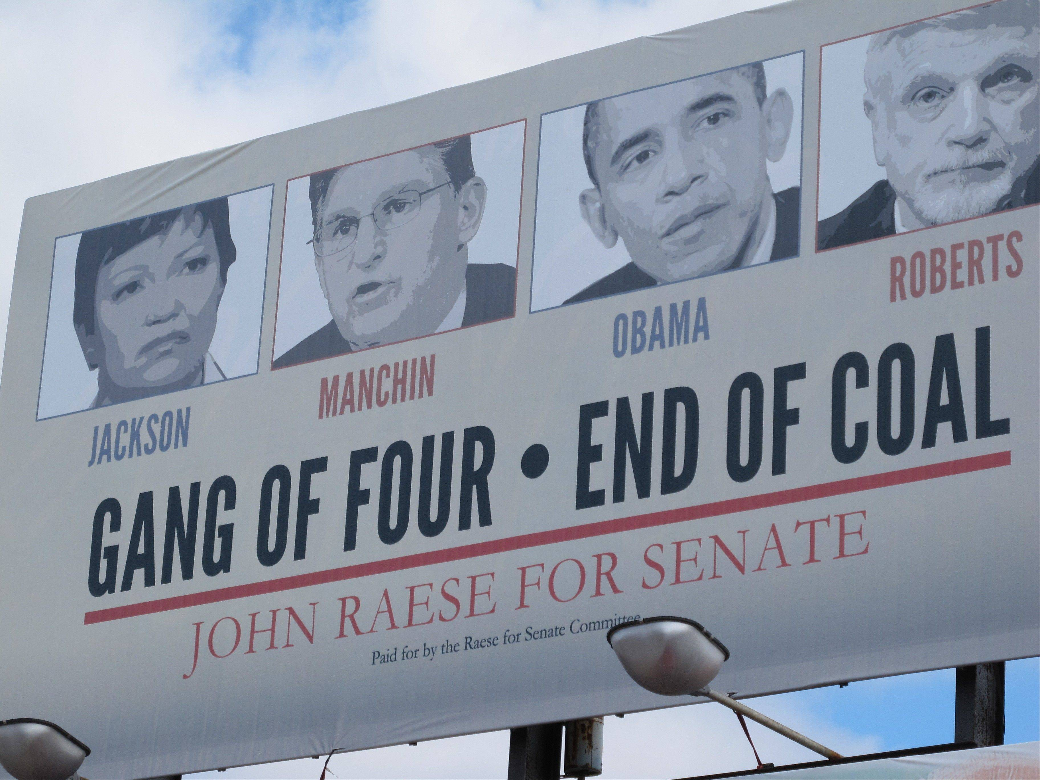 "Republican candidates are using the idea of a ""war on coal"" in their campaigns this year, as in this sign that targets incumbent Democratic U.S. Sen. Joe Manchin in Morgantown, W.Va., last Tuesday. Once, coal miners were literally at war with their employers. Today, their descendants are allies in a rhetorical war playing out across eastern Kentucky, southwestern Virginia and all of West Virginia."