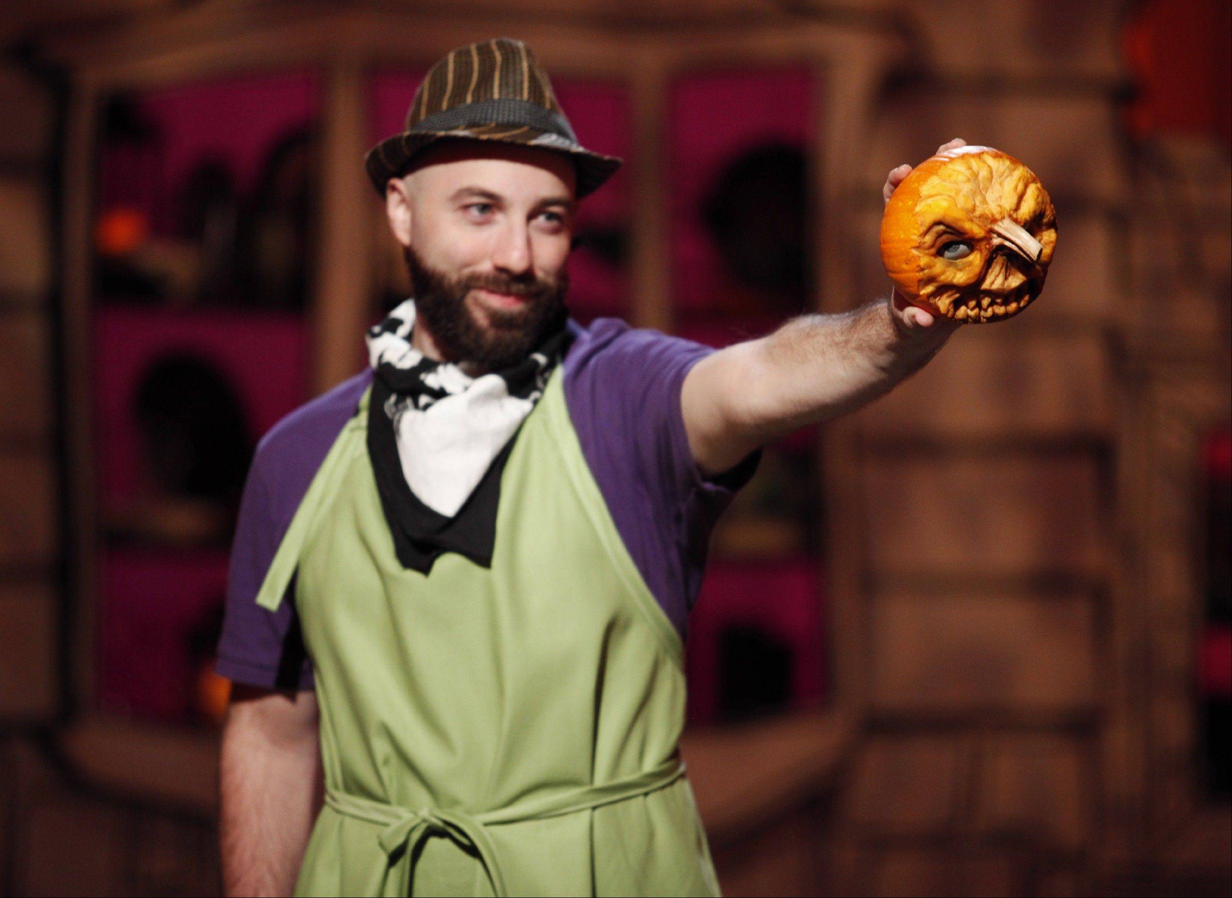 "Pumpkin carver Marc Evan of the Food Network's ""Halloween Wars"" team Dead Men Walking shows off a small pumpkin carving during the reality TV show's second season."