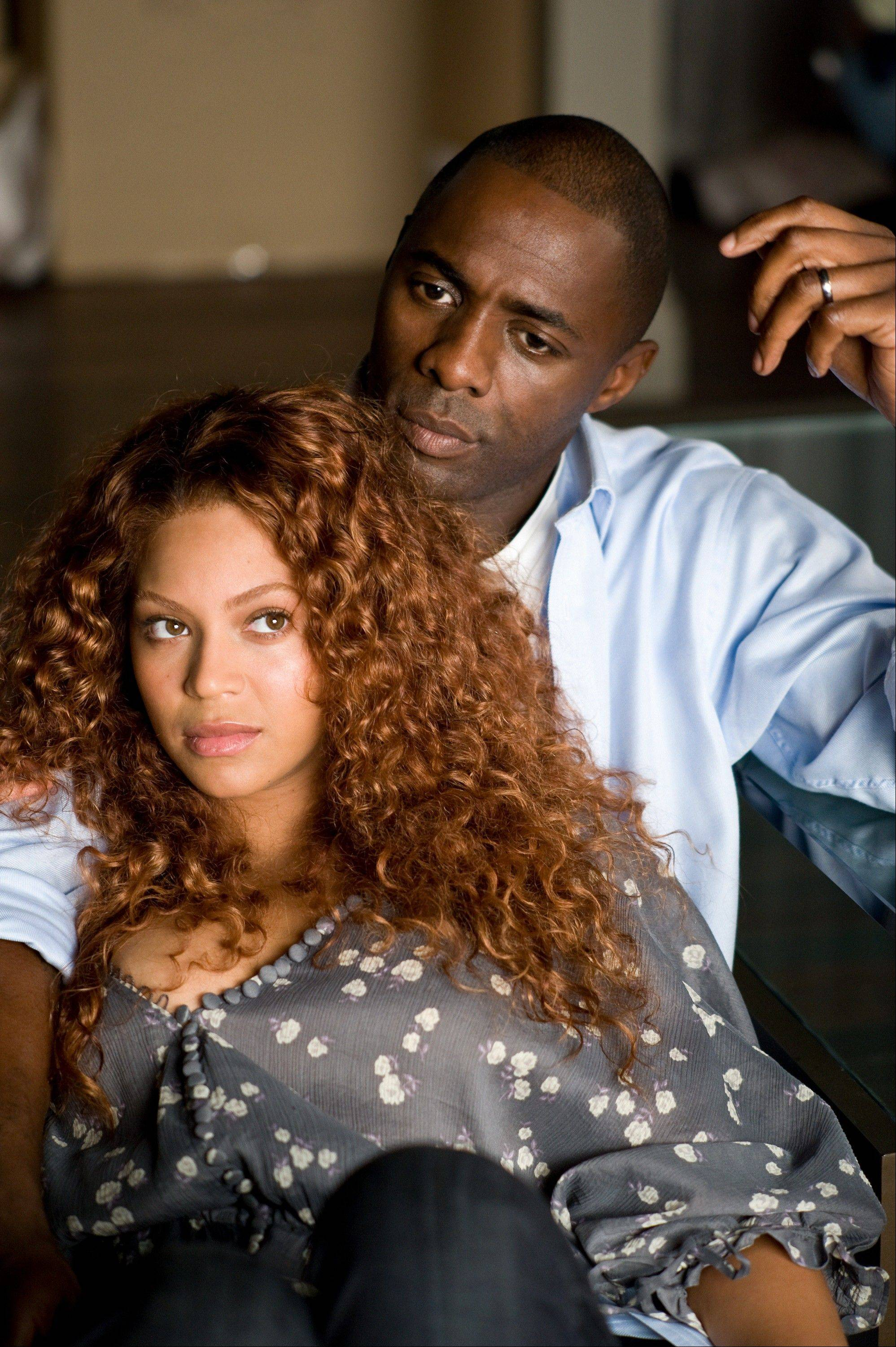 "Beyoncé Knowles and Idris Elba are shown in a scene from the film ""Obsessed."""