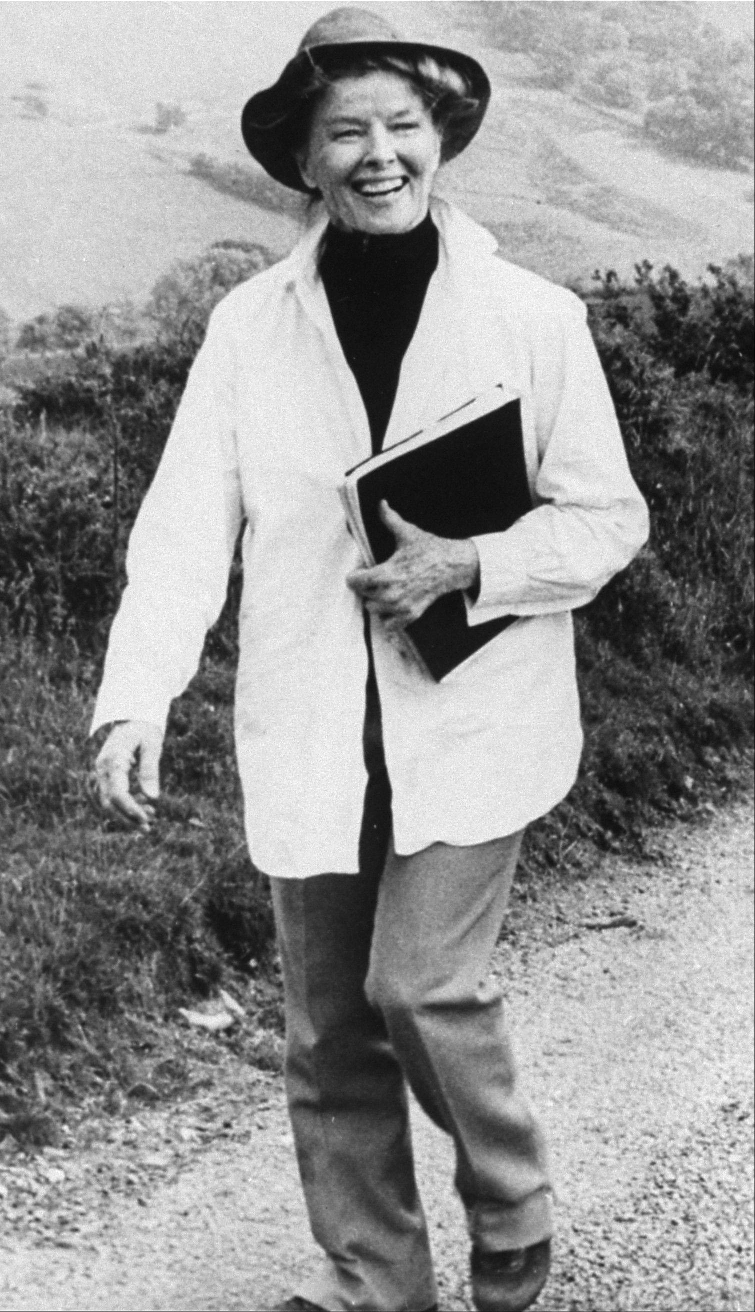 "Actress Katharine Hepburn strolls down a country lane on location near London during the filming of the TV movie ""The Corn Is Green"" in 1979."