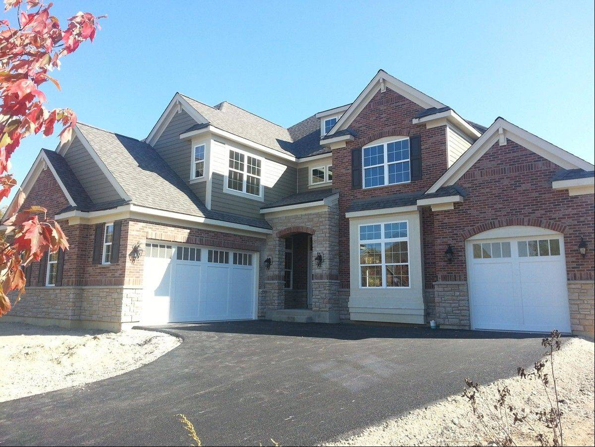 This brick and stone, four-bedroom home is ready for October delivery at Ravenna of Long Grove, a community of 20 estate-style single-family homes in Long Grove.