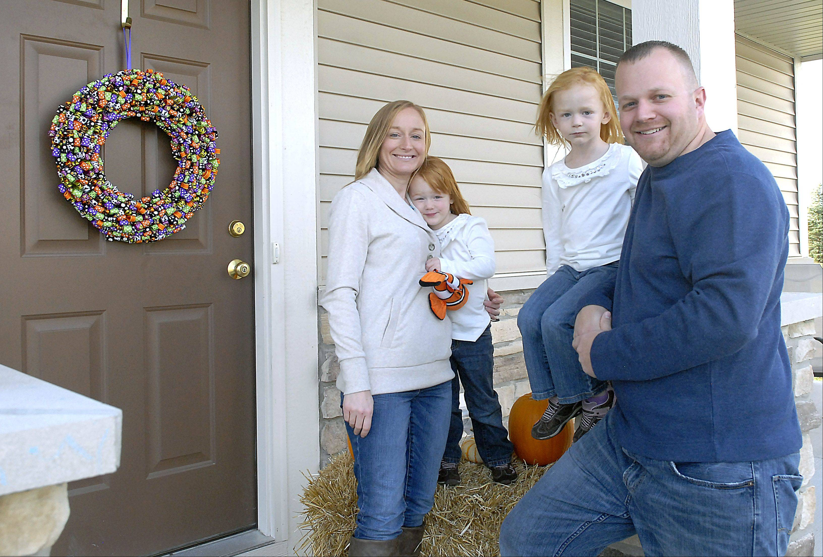 Kari and Todd Waller, with daughters Brooke, 2, and Madison, 4, recently moved to the Cambridge Lakes subdivision in Pingree Grove.