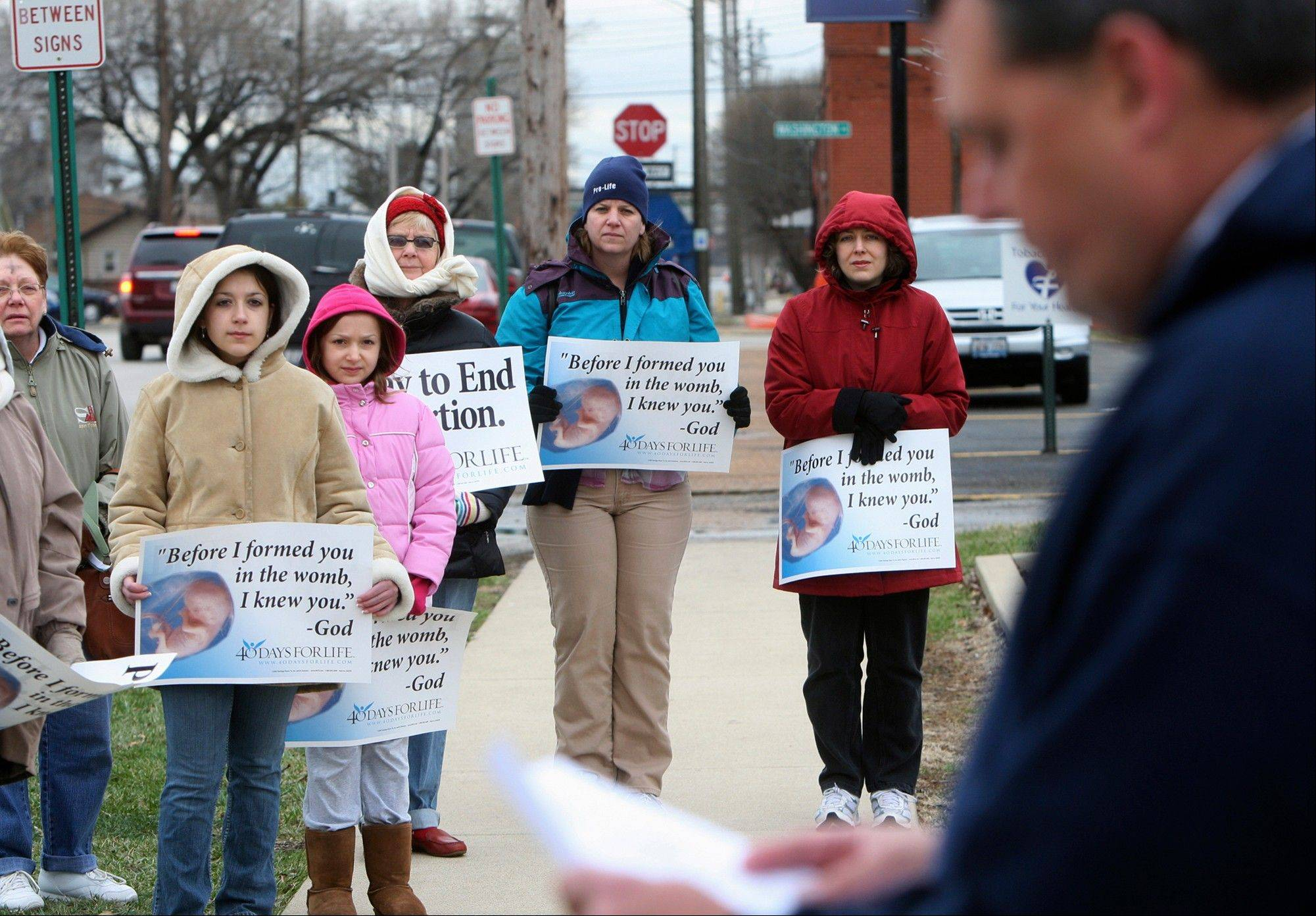 Anti-abortion protesters gather outside the Hope Clinic for Women in Granite City, Ill., as Rev. Chris Comerford, right, from St. Elizabeth's Catholic Church in Granite City speaks out against the abortion clinic.