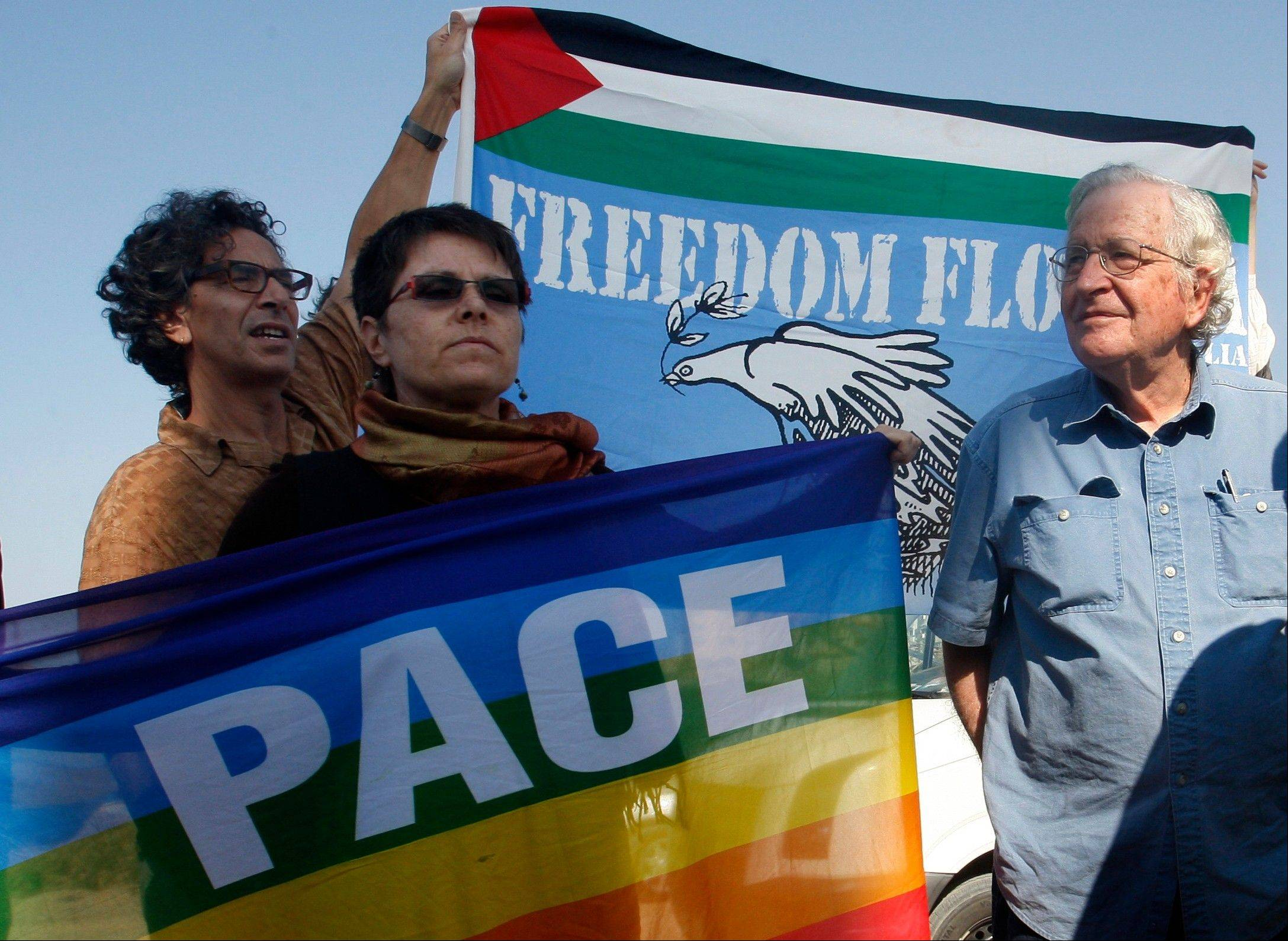 Jewish-American scholar and activist Noam Chomsky, right, stands during a press conference Saturday to support the Gaza-bound flotilla in the port of Gaza City.