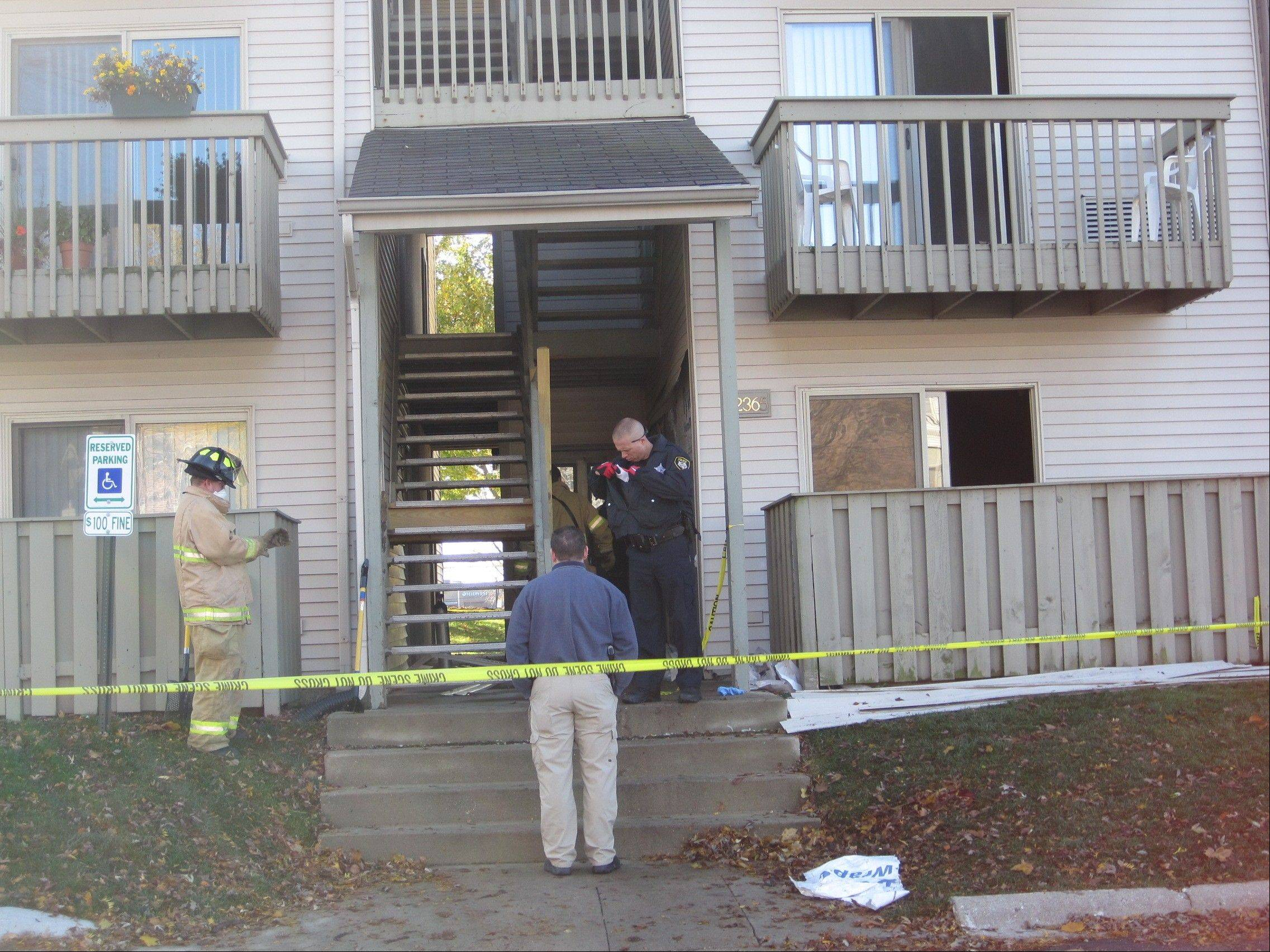 Members of the Mount Prospect Fire Department and investigators from the Mount Prospect Police Department and the Office of the State Fire Marshal were outside an apartment where a 69-year-old woman died after a fire early Saturday.