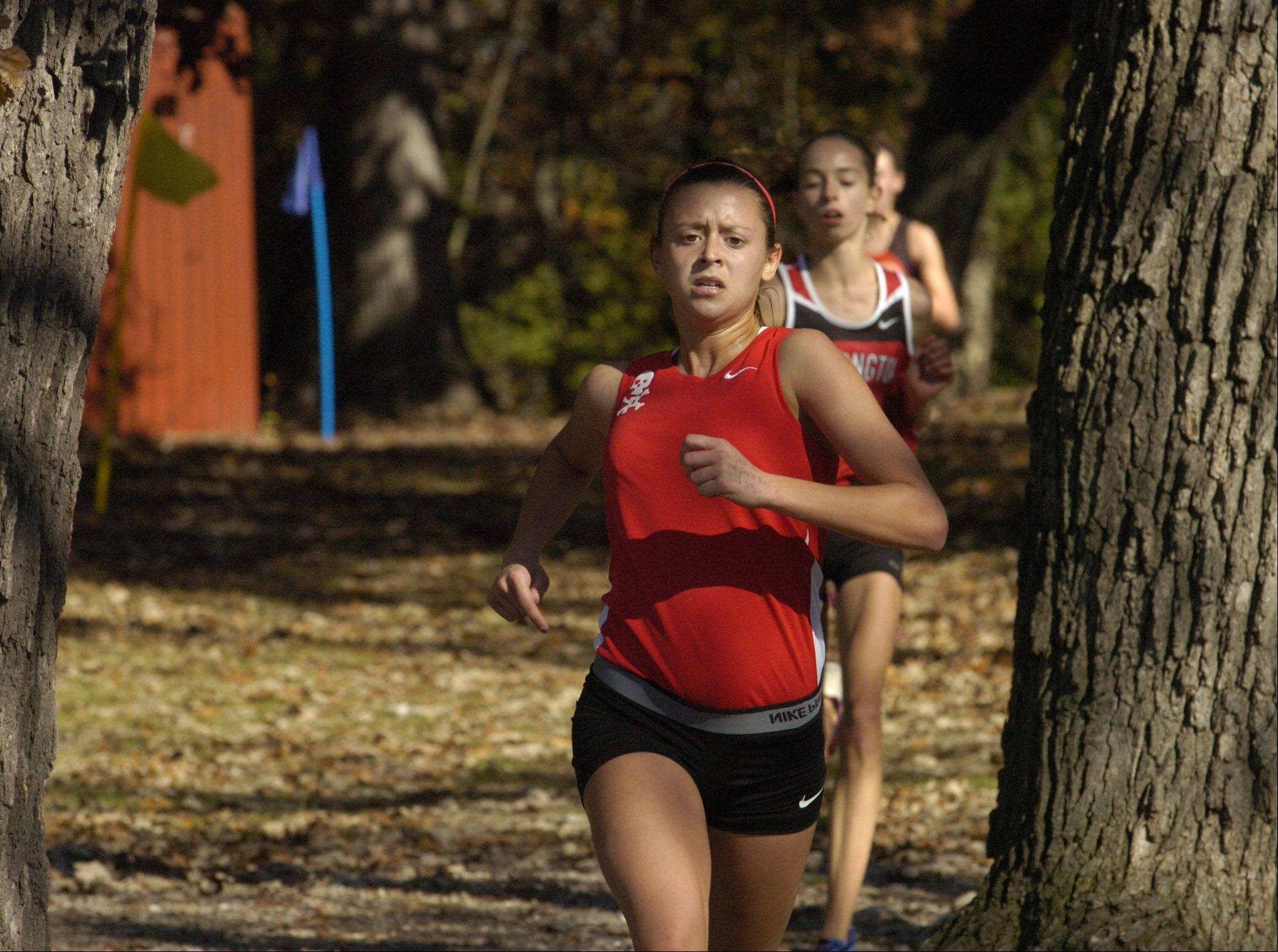 Palatine's Tess Wasowicz leads Barrington's Lauren Conroy through the woods during Class 3A Grant cross country regional. Wasowicz and Conroy finished 1-2.