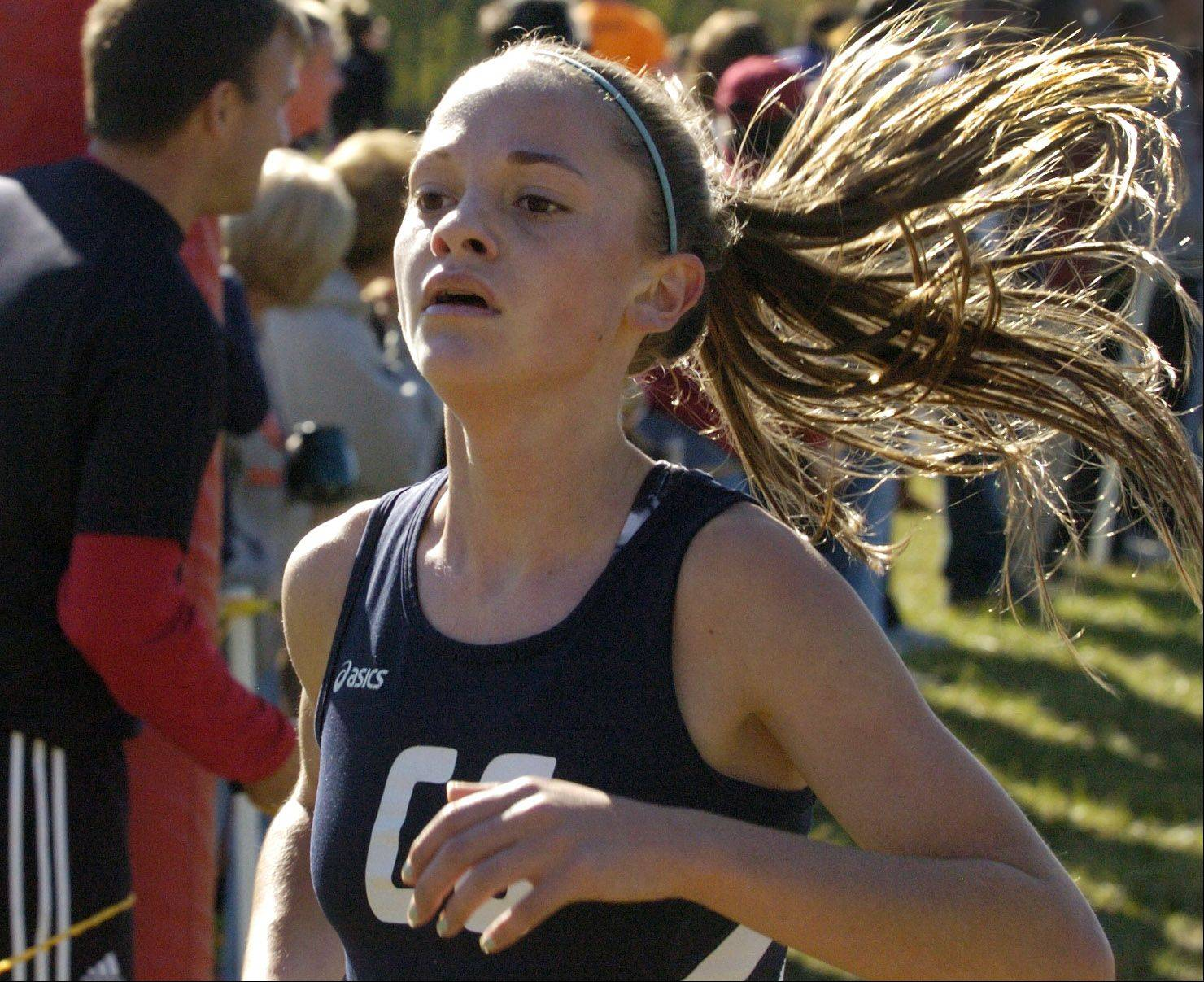 Cary-Grove's Talia Duzey heads for fifth place in the Class 3A Grant cross country regional.