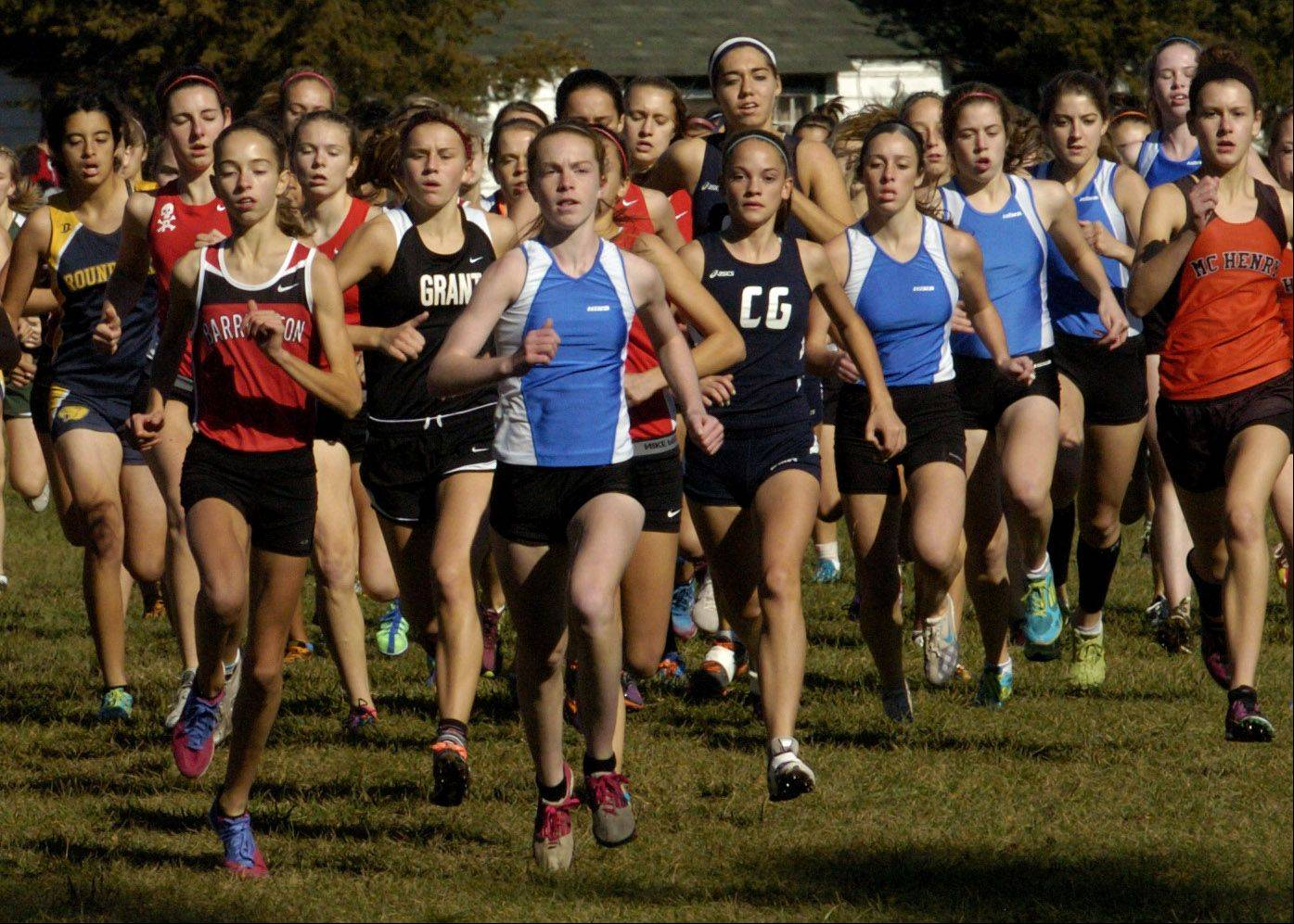 Lake Zurich girls are in the thick of it, center and right, at the start of the girls Class 3A Grant cross country regional.