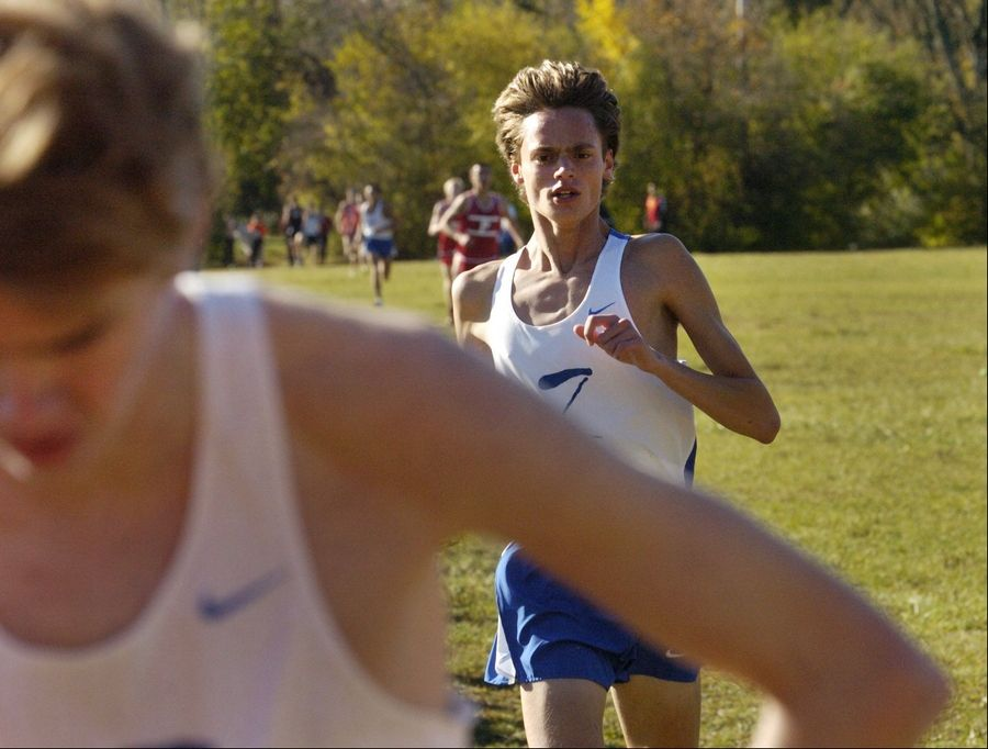 Alex Milner of Lake Zurich finishes third, just behind teammate Trevor Kuehr, foreground, at the Class 3A Grant cross country regional.