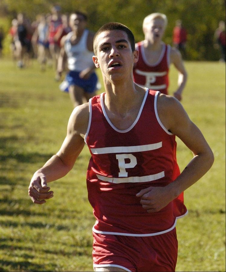 Palatine's Christian Zambrano finishing fourth at the Class 3A Grant cross country regional.