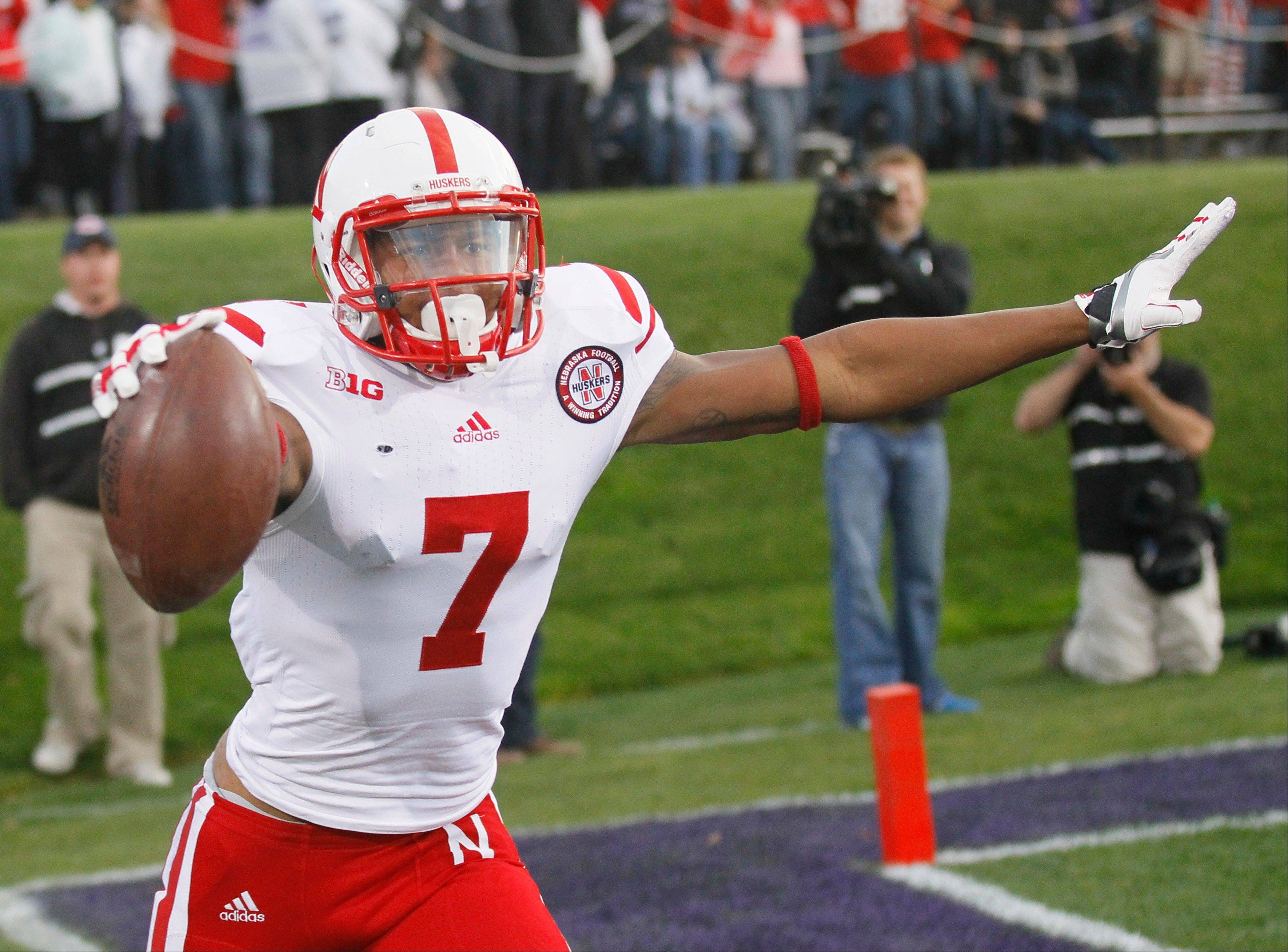 Nebraska wide receiver Taariq Allen (7) celebrates his touchdown catch from quarterback Taylor Martinez during the second half of an NCAA college football game against Northwestern, Saturday, Oct. 20, 2012, in Evanston. Nebraska won 29-28.