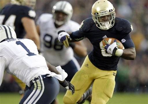 Theo Riddick is Notre Dame's smallest running back but Brigham Young learned he's got no shortage of power.He sparked a ground game that ground out 270 yards, with his housemate, Cierre Wood, getting 114 yards and George Atkinson III scoring the go-ahead touchdown as the Irish rallied for a 17-14 win Saturday.