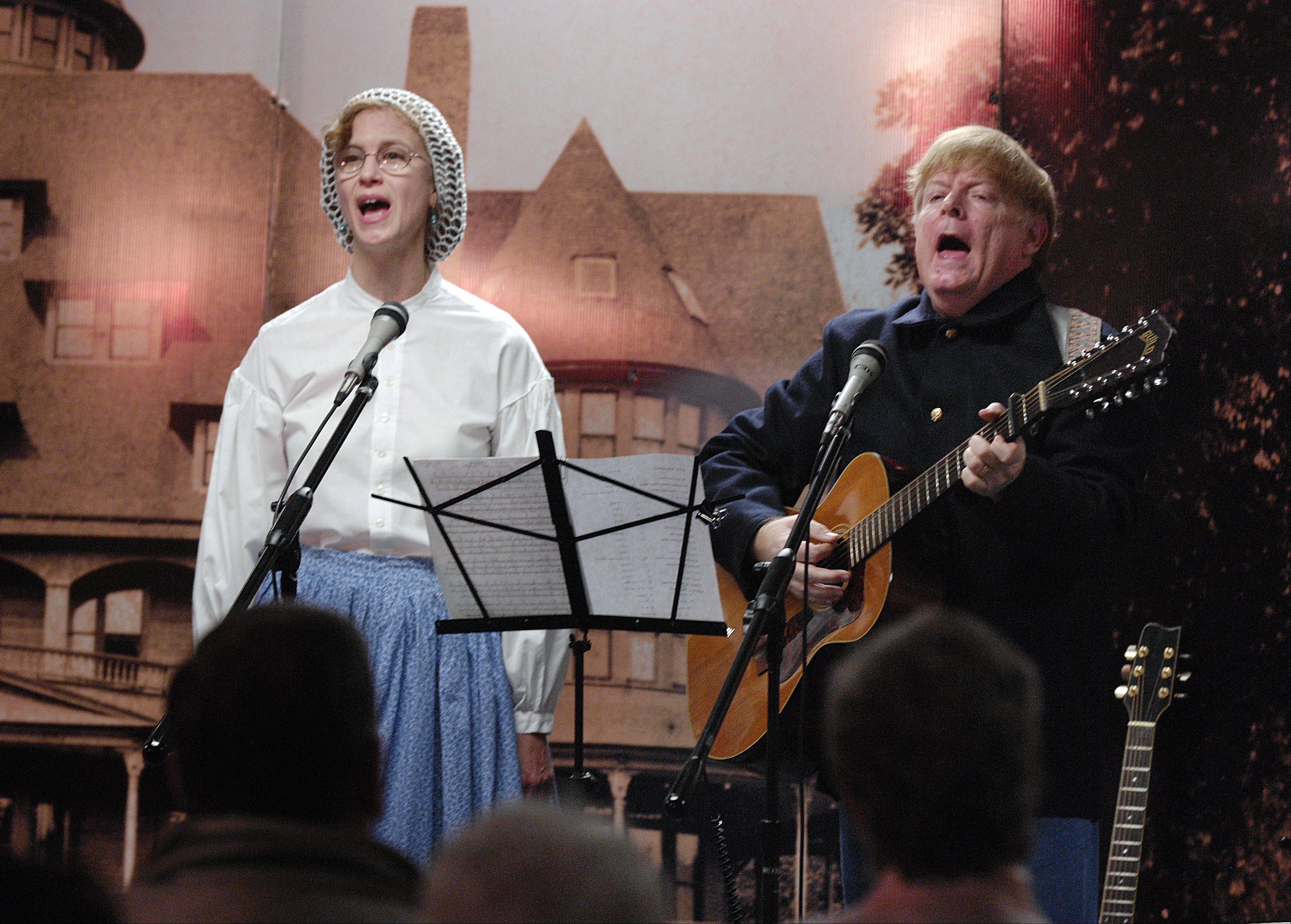 History Singers Kathryn and John Atwood perform songs from the Civil War at the Glen Ellyn Historical Society History Center Sunday. It�s one of several special Civil War programs the historical society has planned for the war�s 150th anniversary.