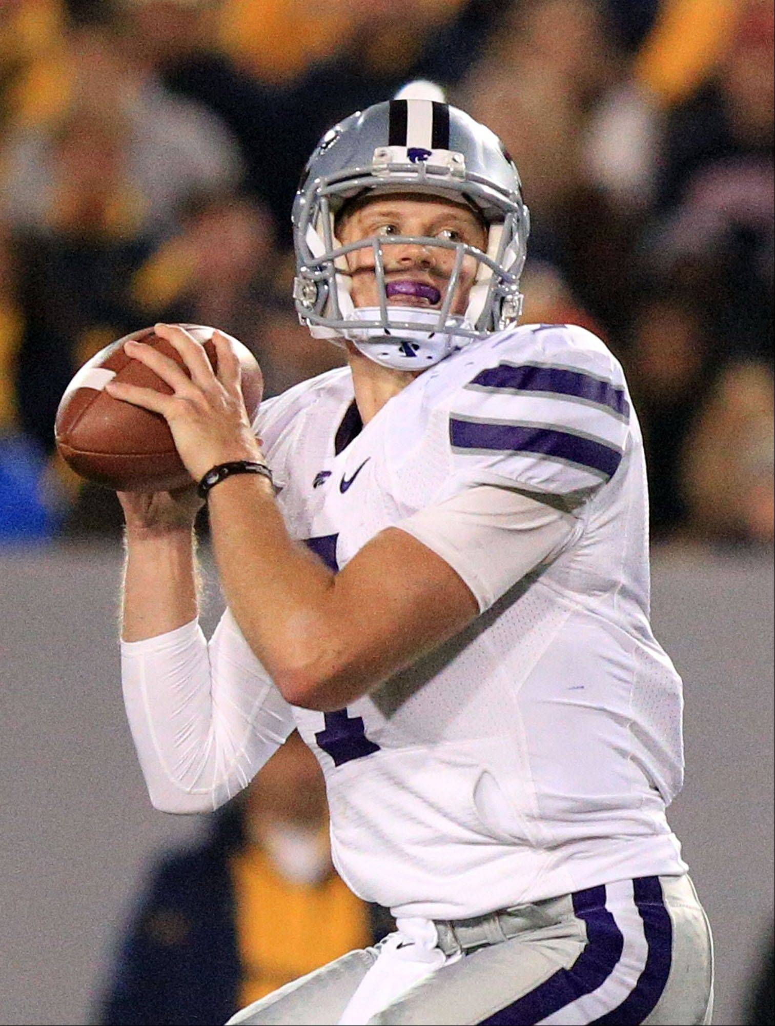 Kansas State quarterback Collin Klein looks to pass Saturday's game against West Virginia in Morgantown, W.Va.
