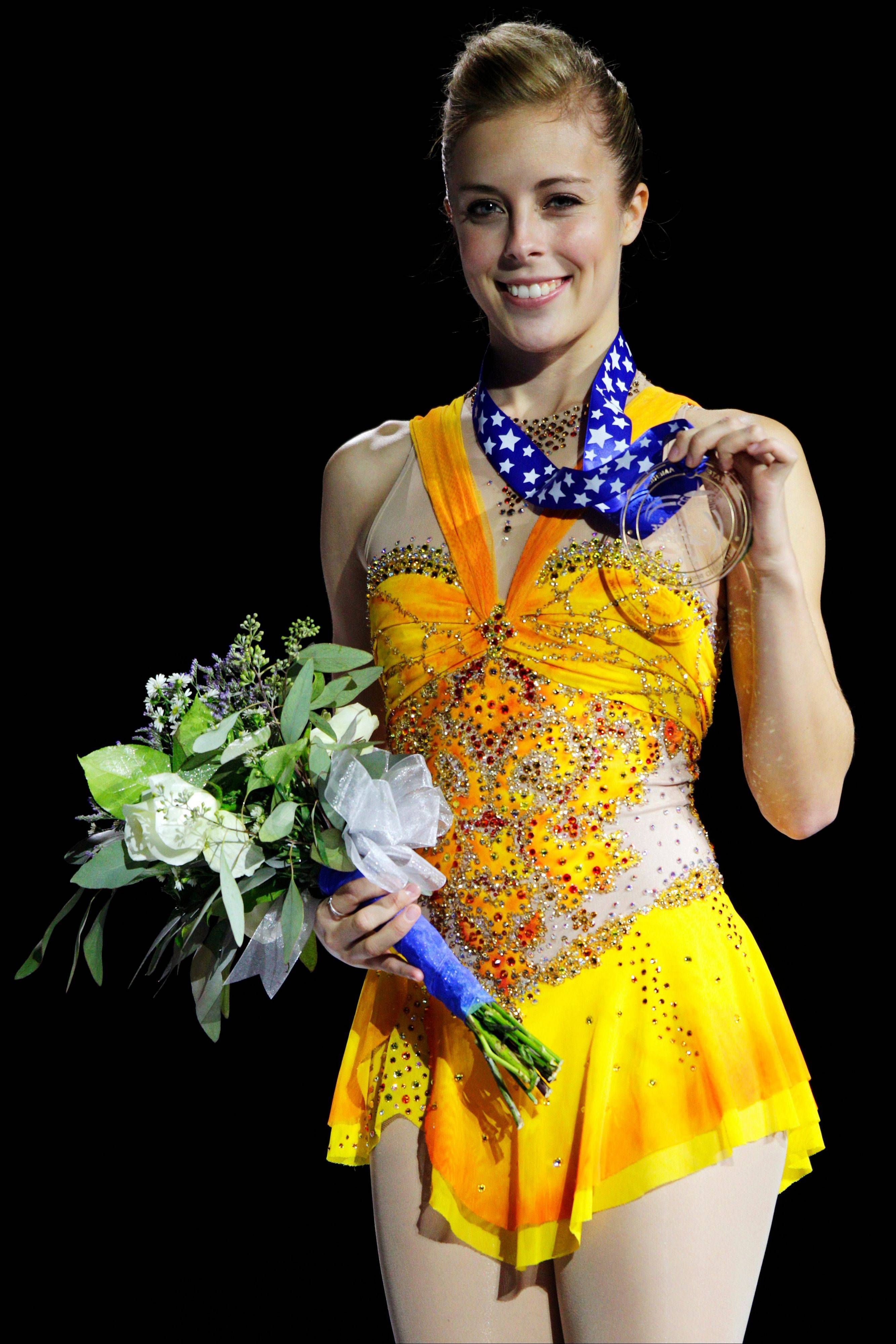 Ashley Wagner stands on the podium after receiving the women�s gold medal Sunday in the Skate America figure skating competition in Kent, Wash.