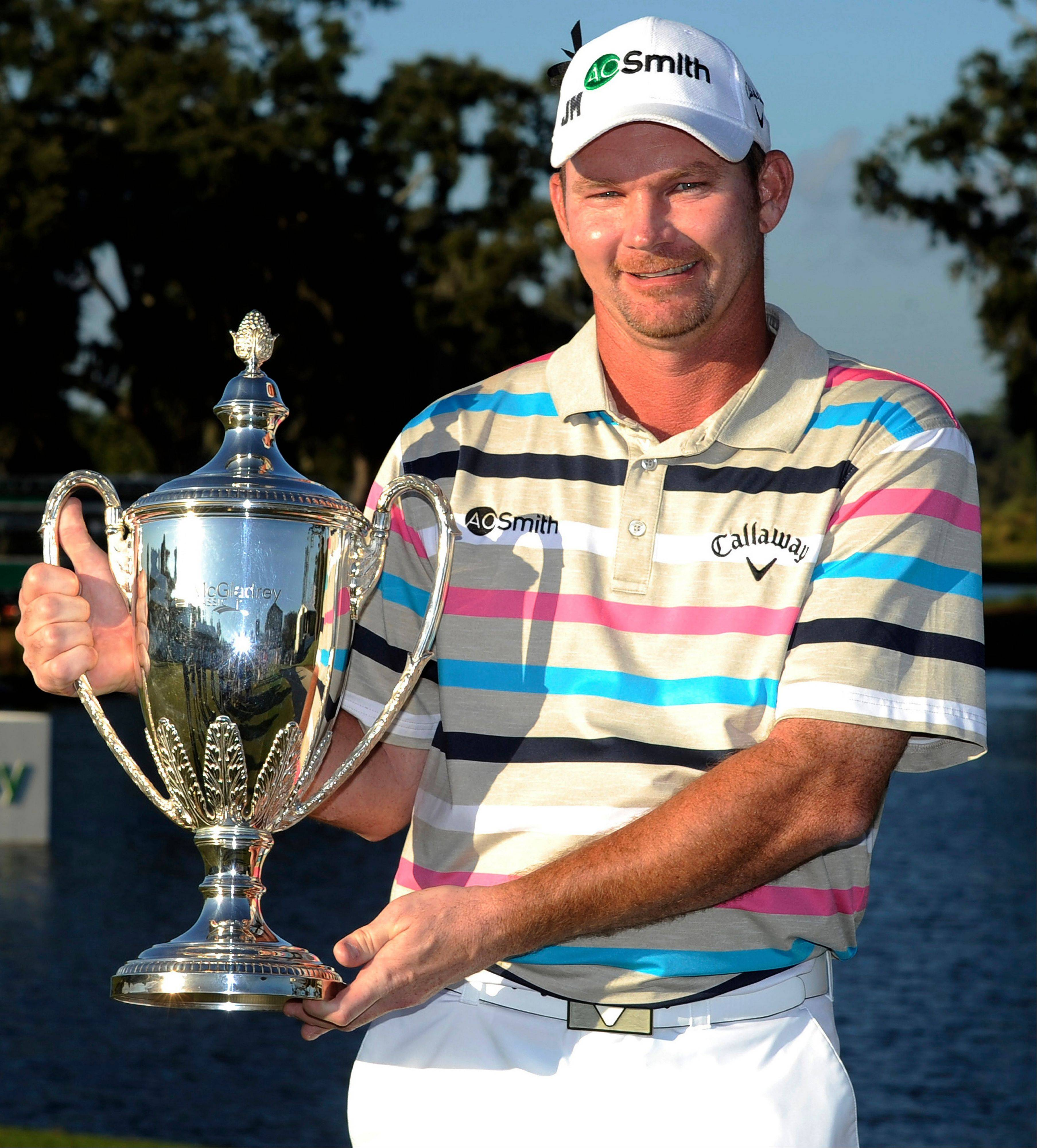 Tommy Gainey holds the trophy after winning the McGladrey Classic PGA Tour golf tournament Sunday in St. Simons Island, Ga.