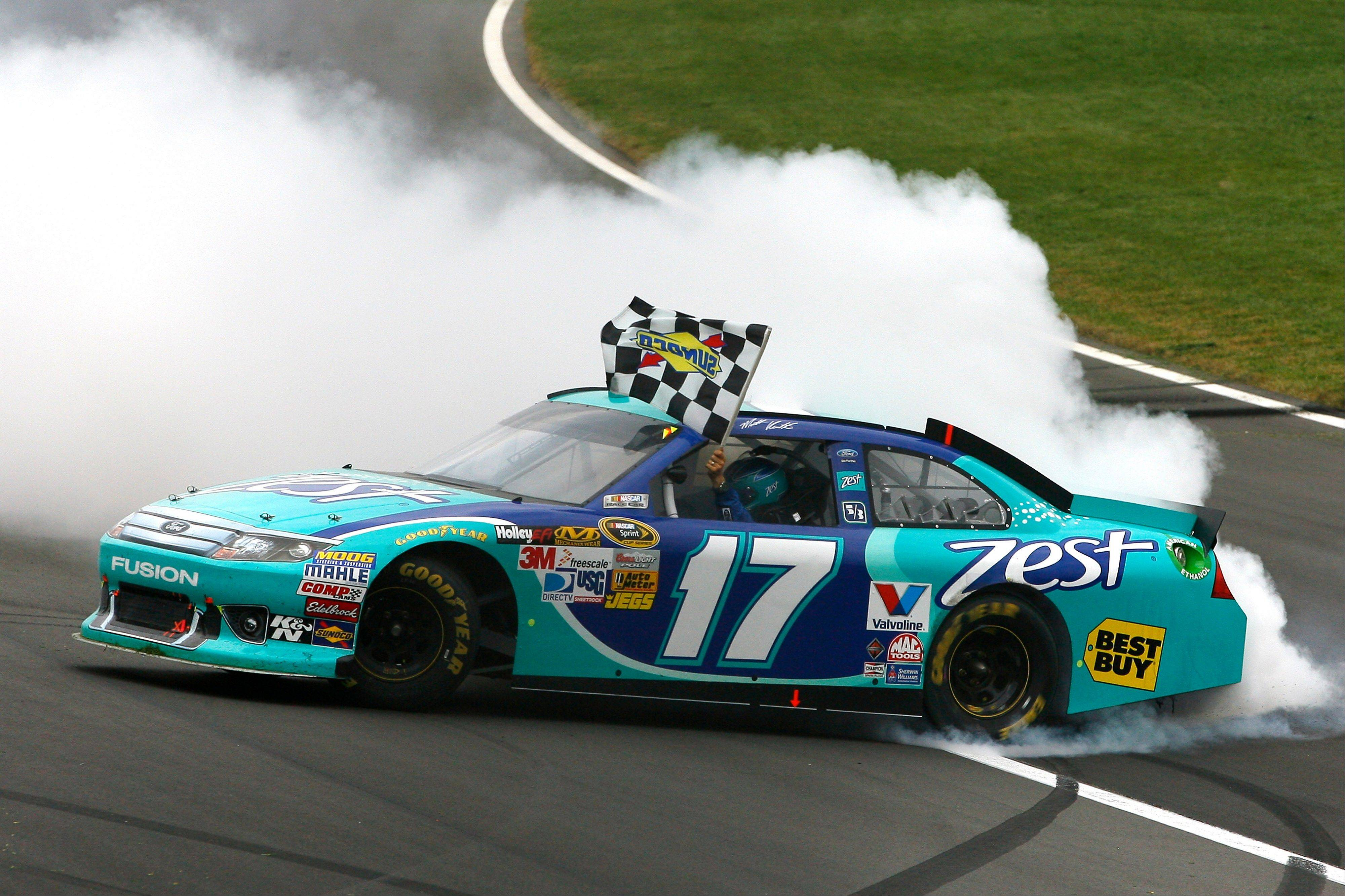 Matt Kenseth does a burnout after winning the NASCAR Sprint Cup Series race at Kansas Speedway on Sunday.