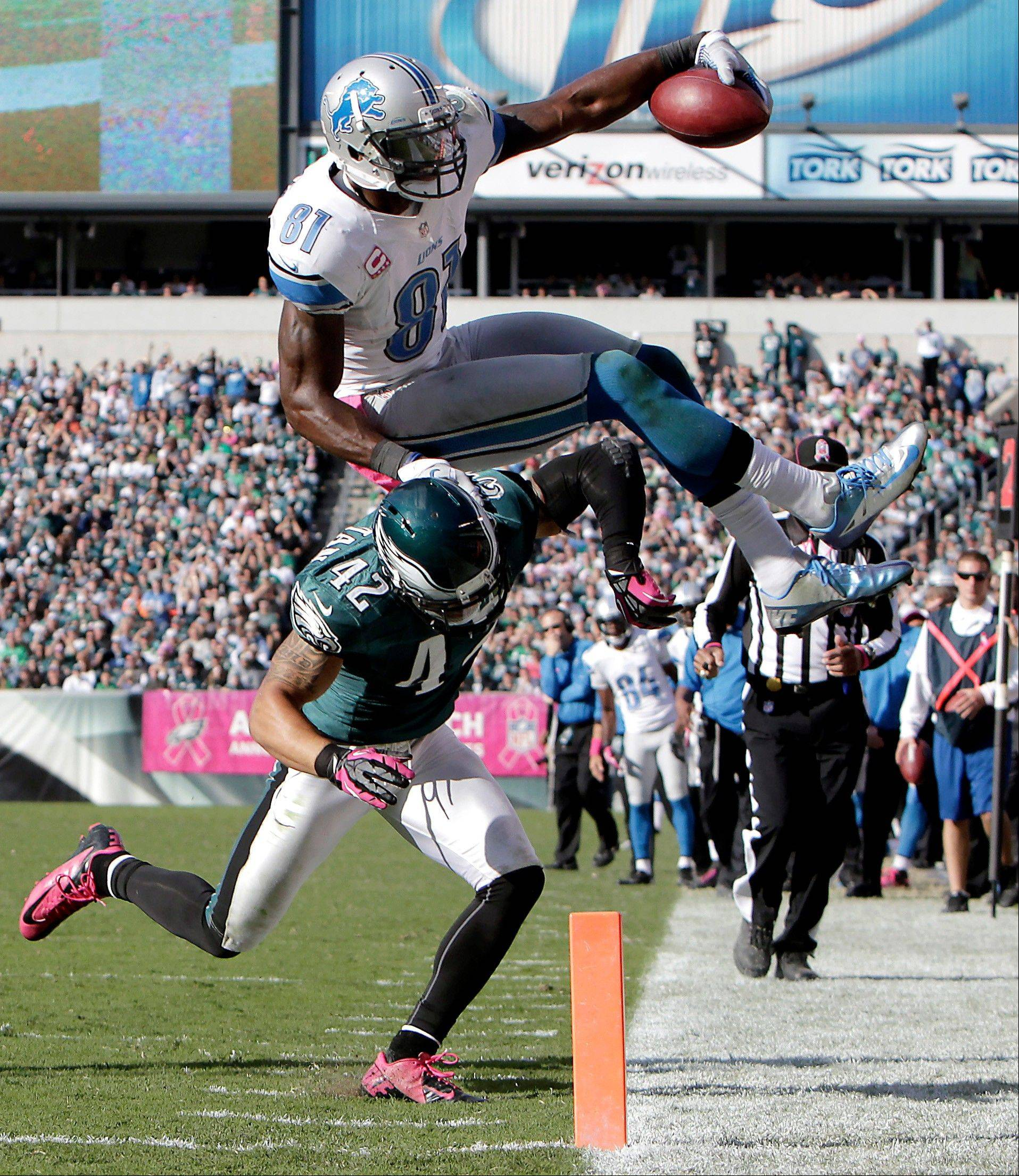 The Eagles� Kurt Coleman knocks Detroit wide receiver Calvin Johnson out of bounds on the 1-yard line last week in Philadelphia.