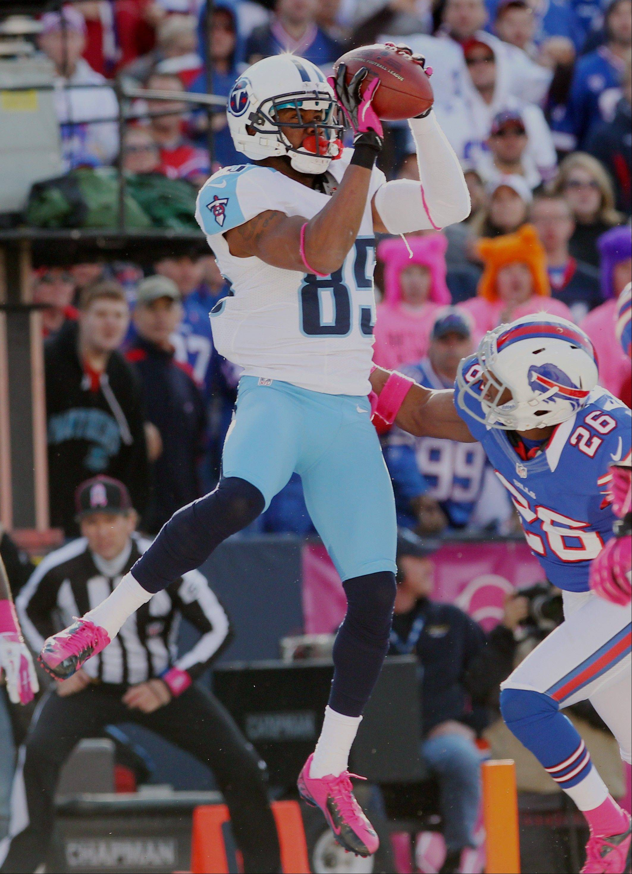 Tennessee Titans wide receiver Nate Washington catches the game-winning touchdown over Buffalo Bills defensive back Justin Rogers Sunday in Orchard Park, N.Y.