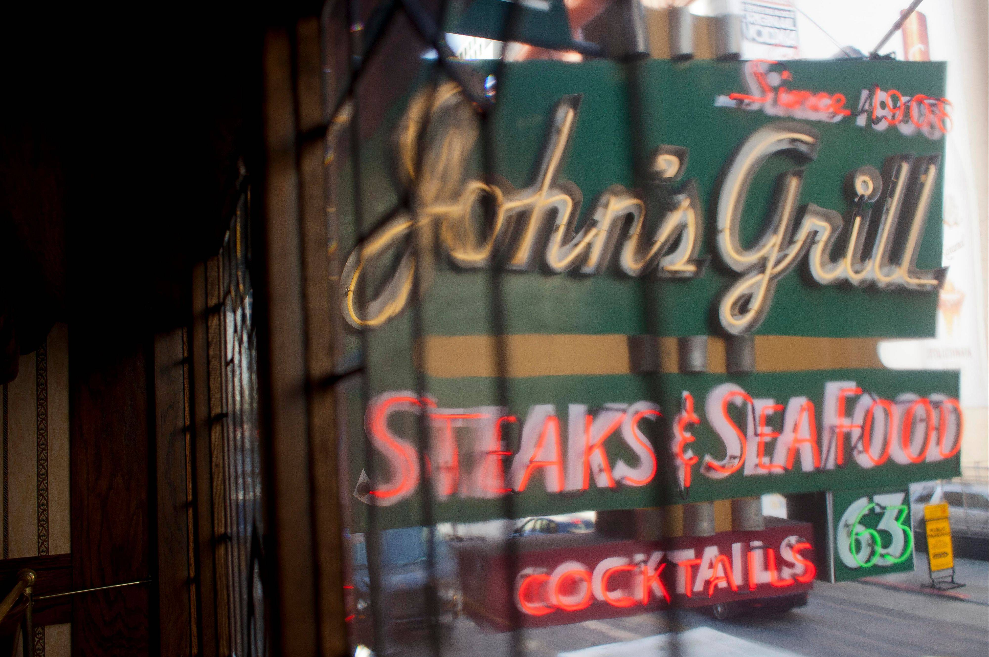 "An old neon sign hangs above John's Grill in San Francisco. One of the city's oldest restaurants, the grill was a setting in author Dashiell Hammett's ""The Maltese Falcon."""