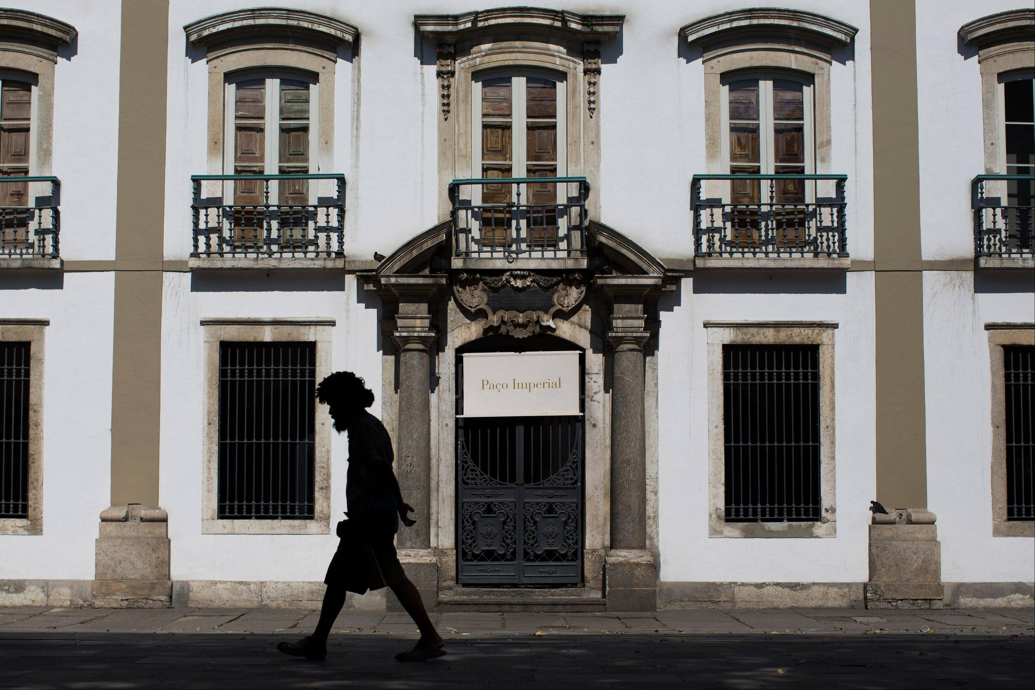 A man walks past the Paco Imperial or Royal Palace in Rio de Janeiro, the home where the Portuguese royal family settled when they fled Europe just ahead of Napoleon's advancing troops.