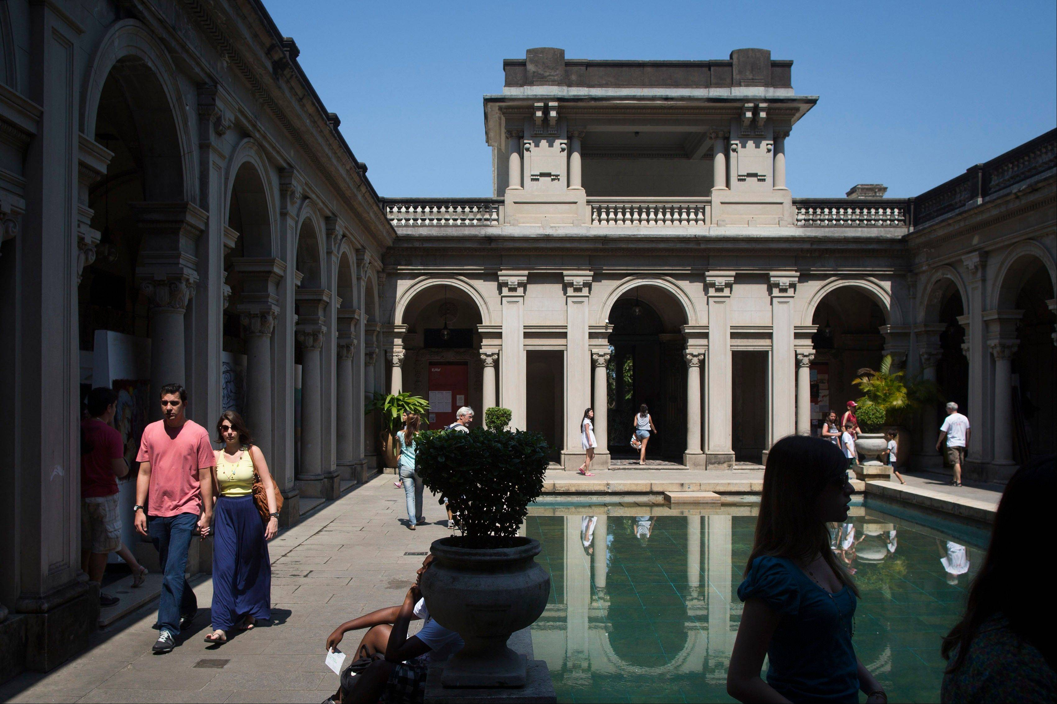 People visit an early 20th century mansion at Parque Lage in Rio de Janeiro, Brazil.