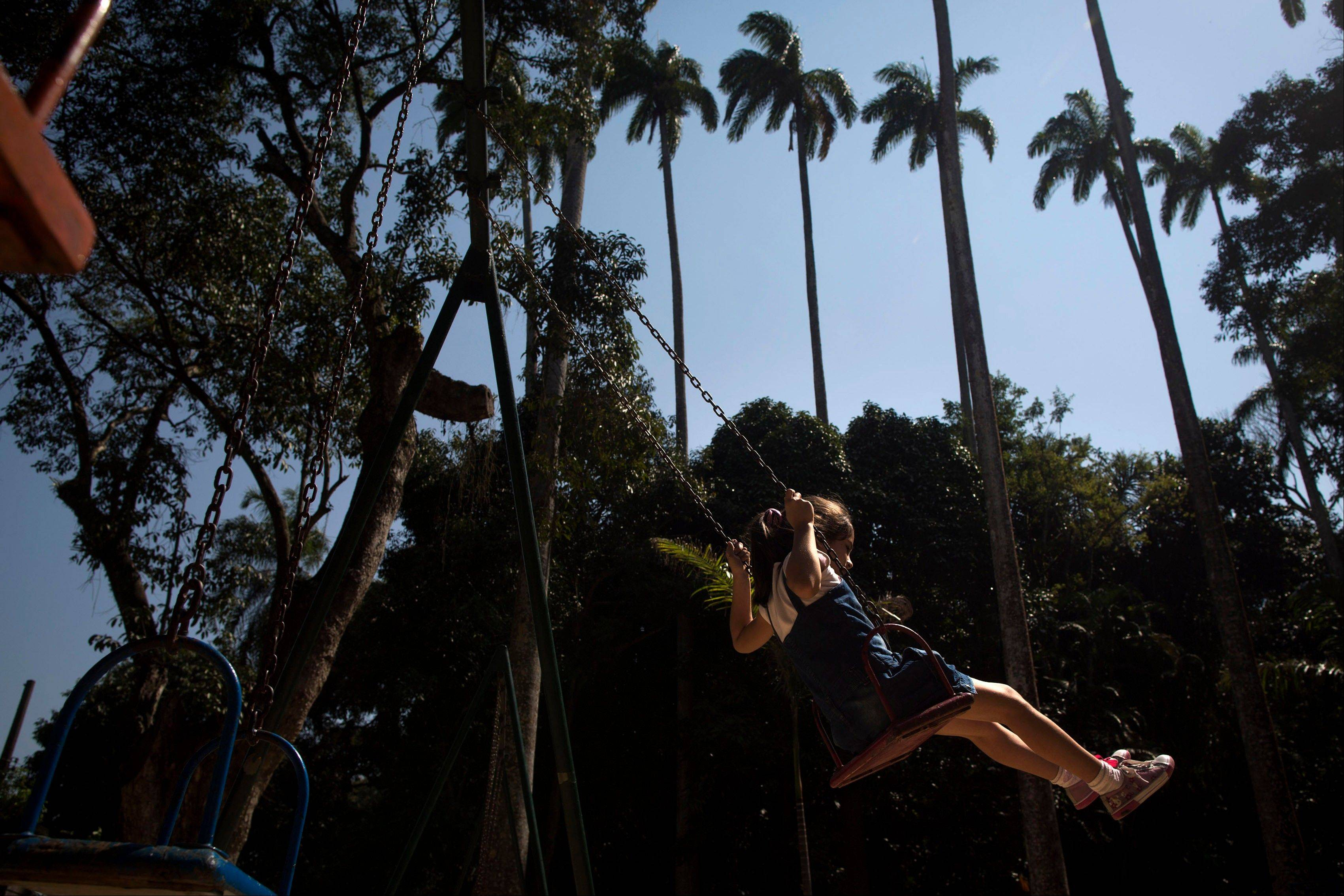A girl swings at Parque Lage. About a half-mile away from the also-gorgeous but not free Jardim Botanico. Parque Lage has as much charm as its better-known neighbor.
