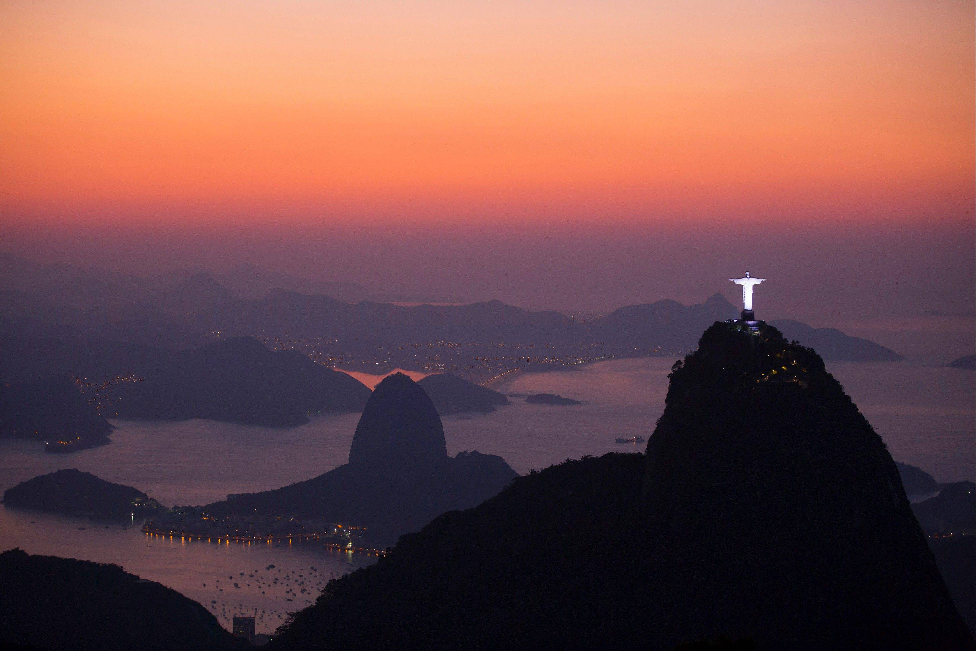 The Christ the Redeemer statue on the top of Corcovado Mountain and Sugar Loaf Mountain.