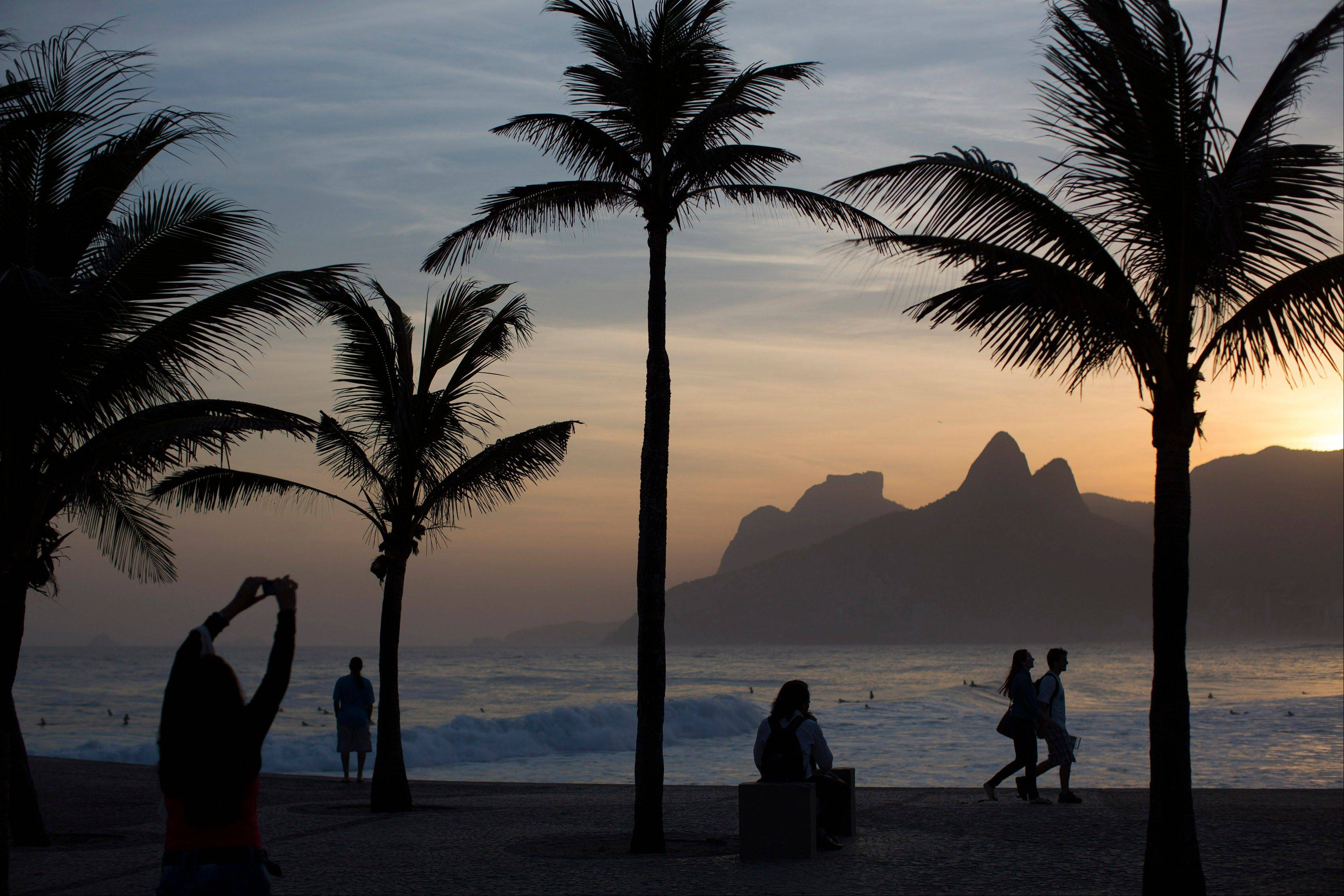 The sunset at Arpoador beach in Rio de Janeiro, Brazil. Rio boasts some of the world's most stunning urban beaches and they're worth several visits.