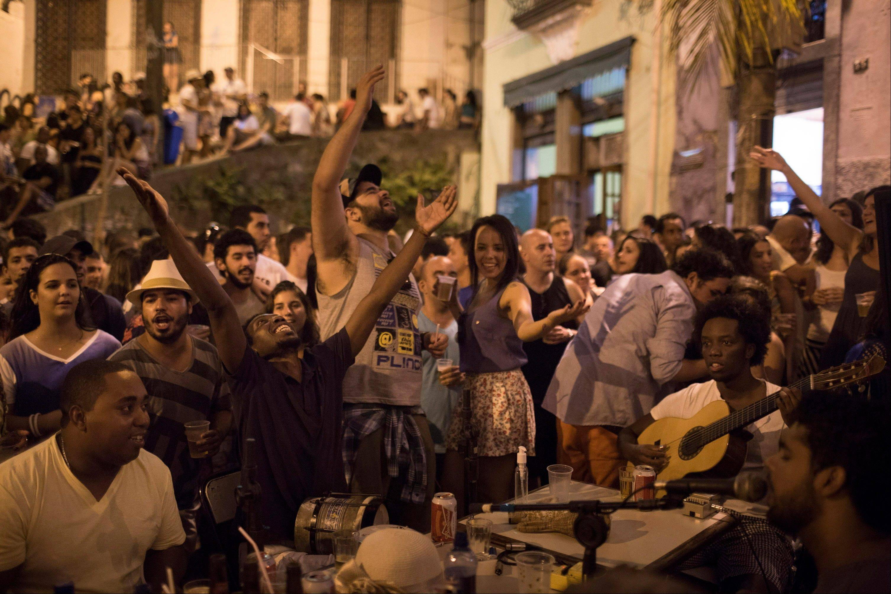 People gather to listen to live Samba music in a plaza called Pedra do Sal. Rio's signature percussion-driven rhythm can be heard in classy indoor music venues, sure, but old-school samba circles can pop up without notice.