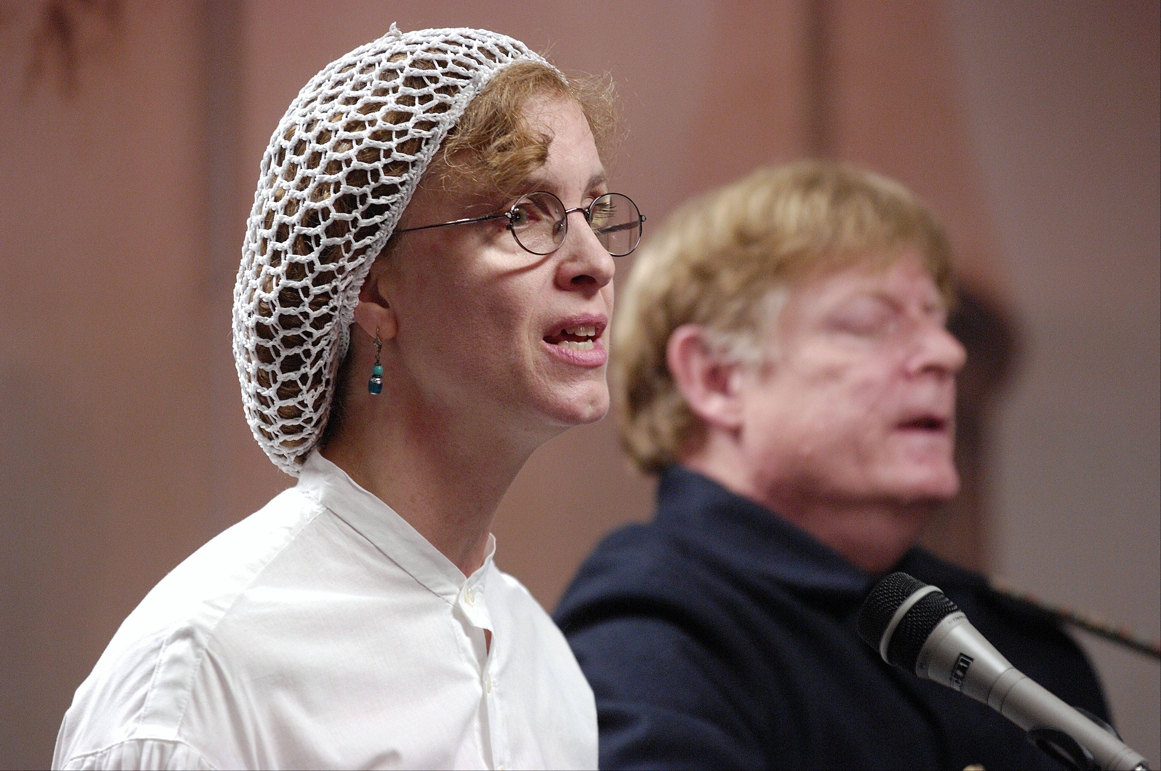 History Singers Kathryn and John Atwood perform songs from the Civil War at the Glen Ellyn Historical Society History Center Sunday.