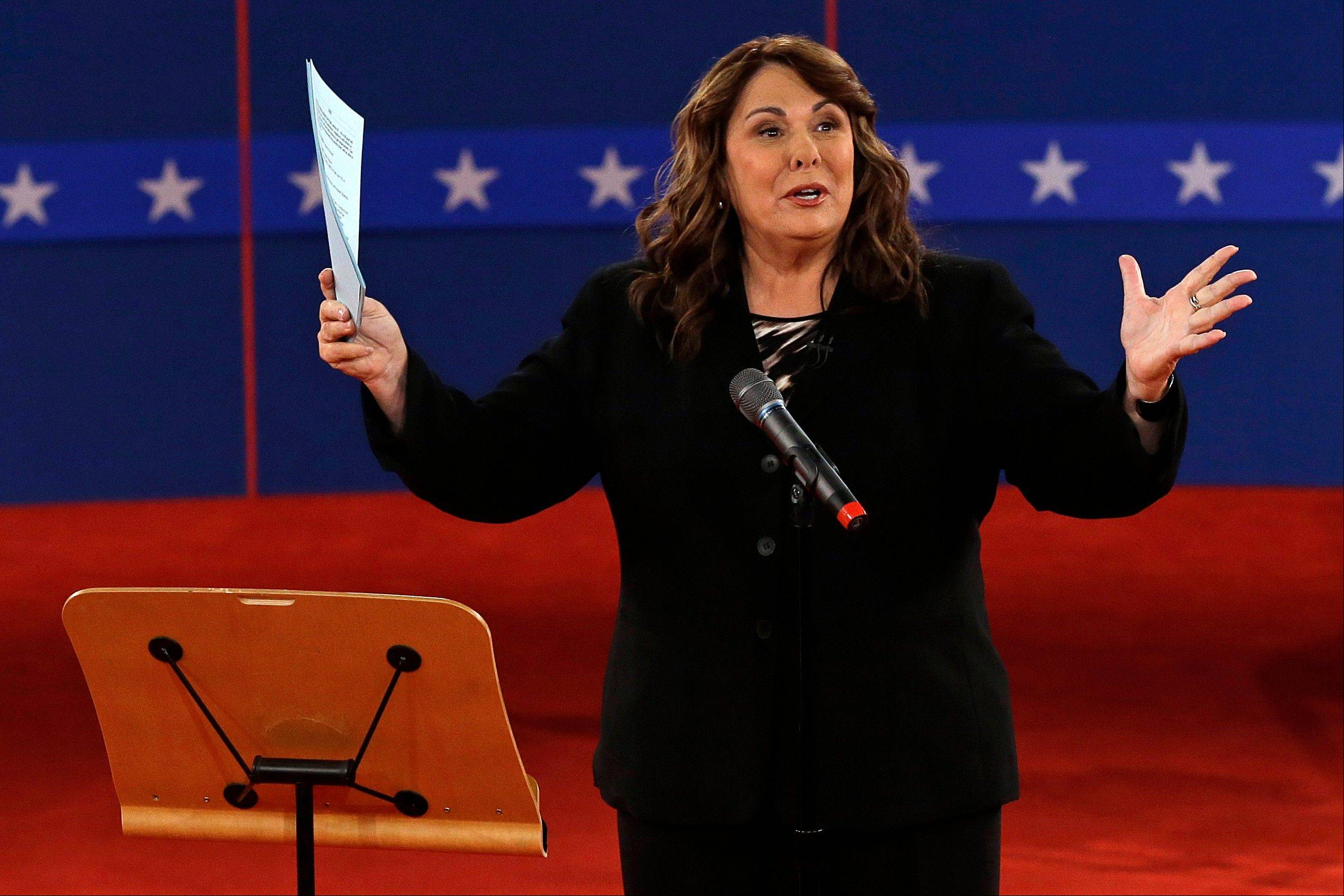 "Moderator Candy Crowley talks to the audience before the second presidential debate at Hofstra University on Tuesday in Hempstead, N.Y. Crowley was criticized for correcting Romney in a dispute over what was said during a presidential address about Libya by saying Obama had referred to an attack on Americans in Benghazi as an ""act of terror."""