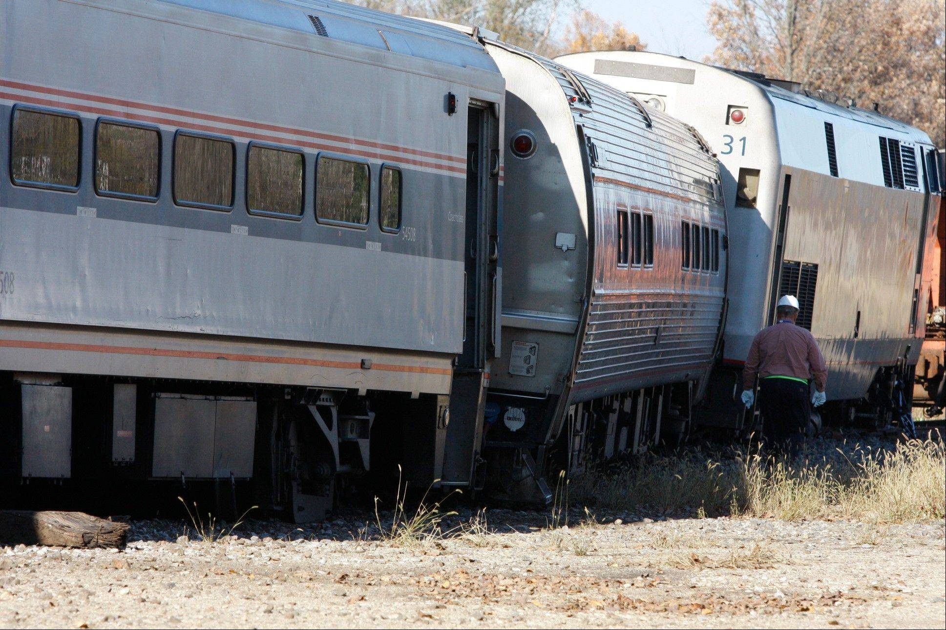 Investigators from Amtrak look over the scene of where a train derailed in Niles, Mich. shortly before 10:30 a.m. Sunday. About a dozen passengers and crew on an Amtrak train from Chicago to Pontiac, north of Detroit, were injured.