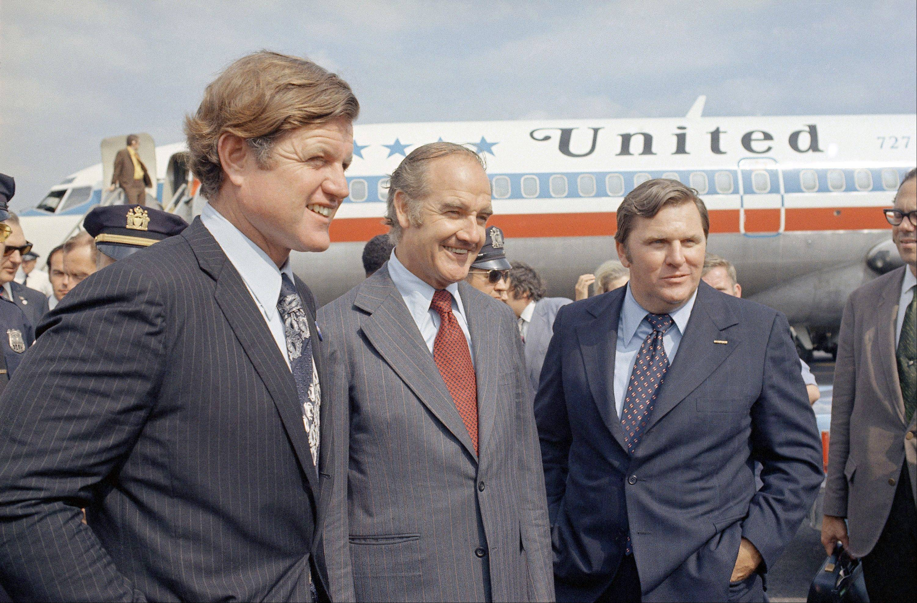 Sen. George McGovern, center, with Sen. Ted Kennedy, left, in New York as they campaign for McGovern for Democratic nominee for president, Sept. 1972.