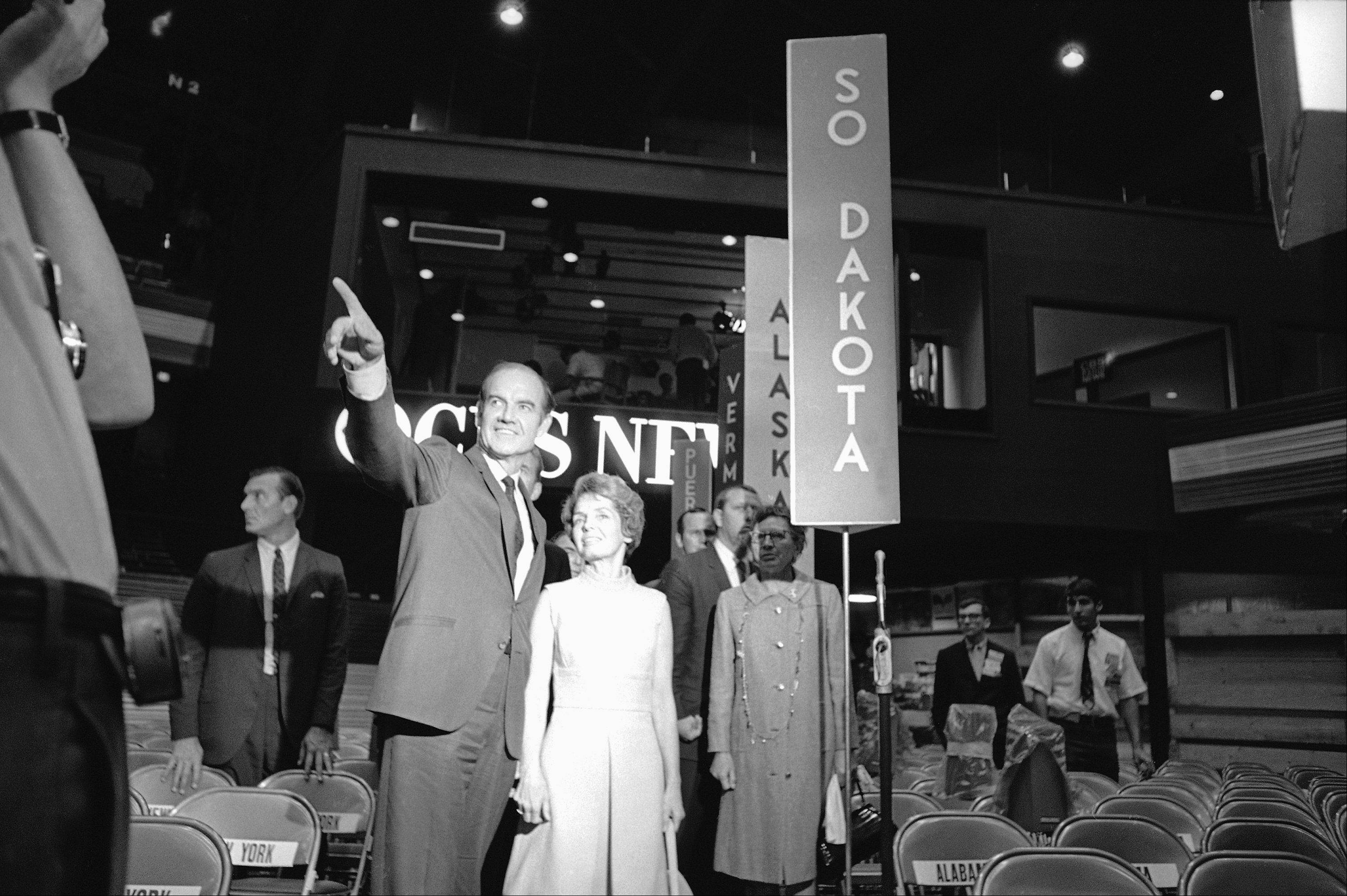 Sen. George McGovern of South Dakota pays a visit with his wife to the floor of the International Amphitheatre in Chicago, August 25, 1968.