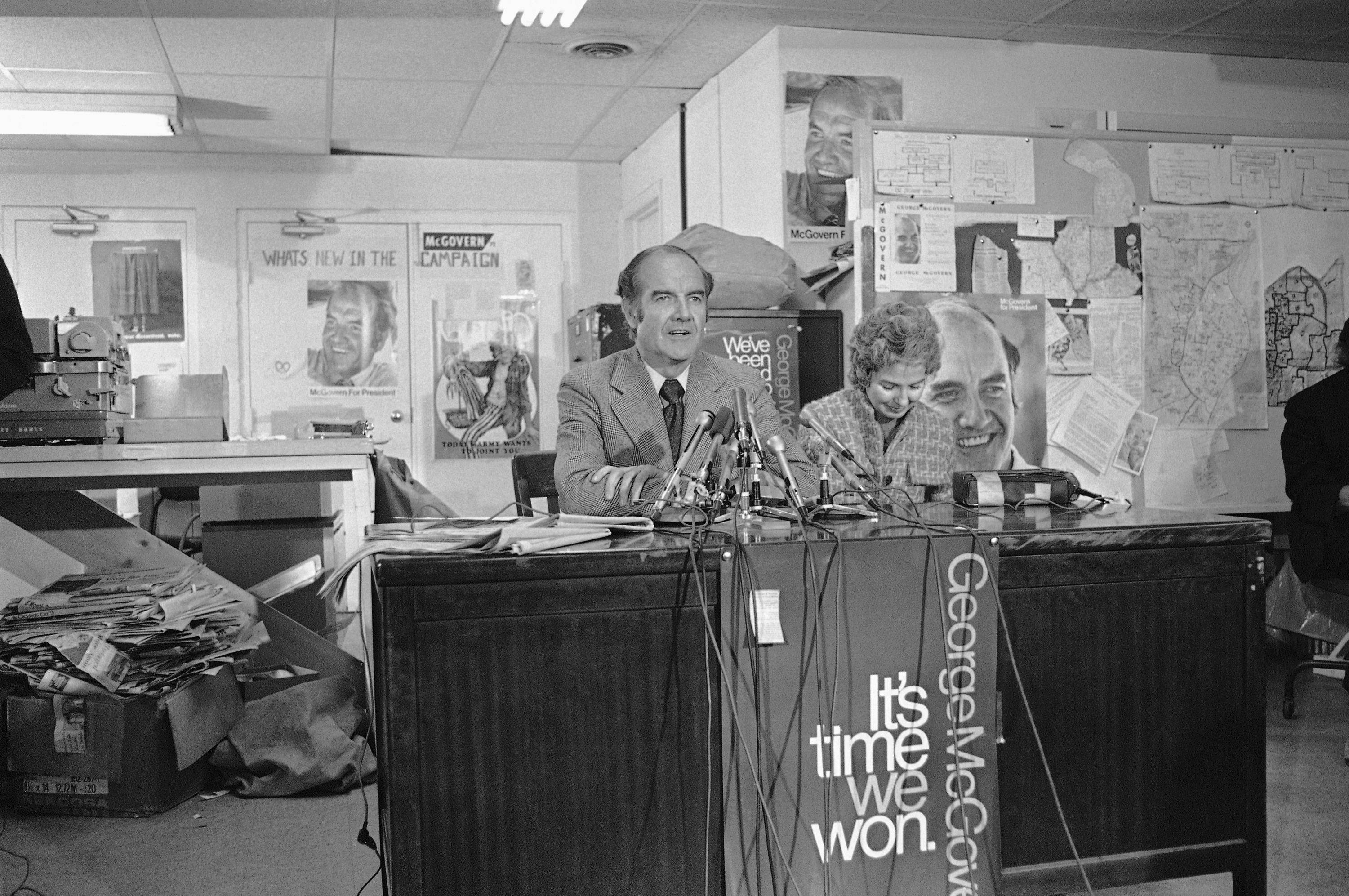 Sen. George S. McGovern tells those gathered at his Washington campaign headquarters the New Hampshire primary has launched him on the road to the nomination, March 8, 1972 in Washington. The South Dakota Democrat then left to campaign for the Florida primary. His wife Eleanor is seated beside him.