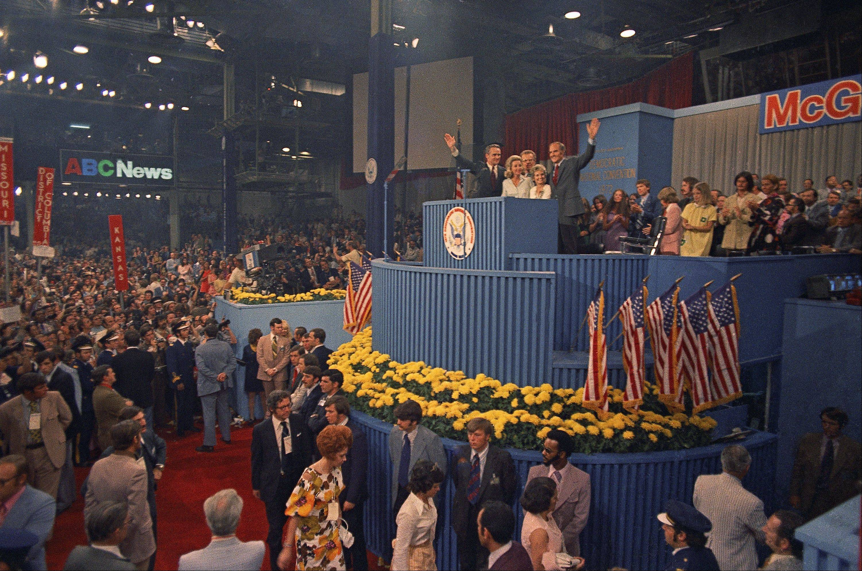 Sen. George McGovern and his running mate Sargent Shriver are shown with their wives on the podium in Miami at the Democratic National Convention, July 1972.