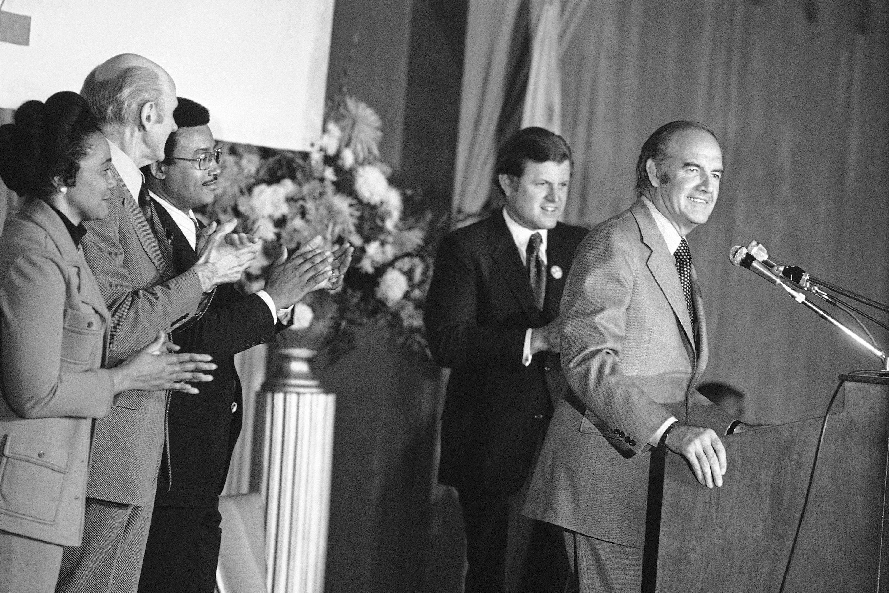 Sen. Edward M. Kennedy doubles over with laughter from a mild needle injected by Sen. George S. McGovern in Los Angeles, Friday, Oct. 27, 1972 at a luncheon for building trades union representatives.