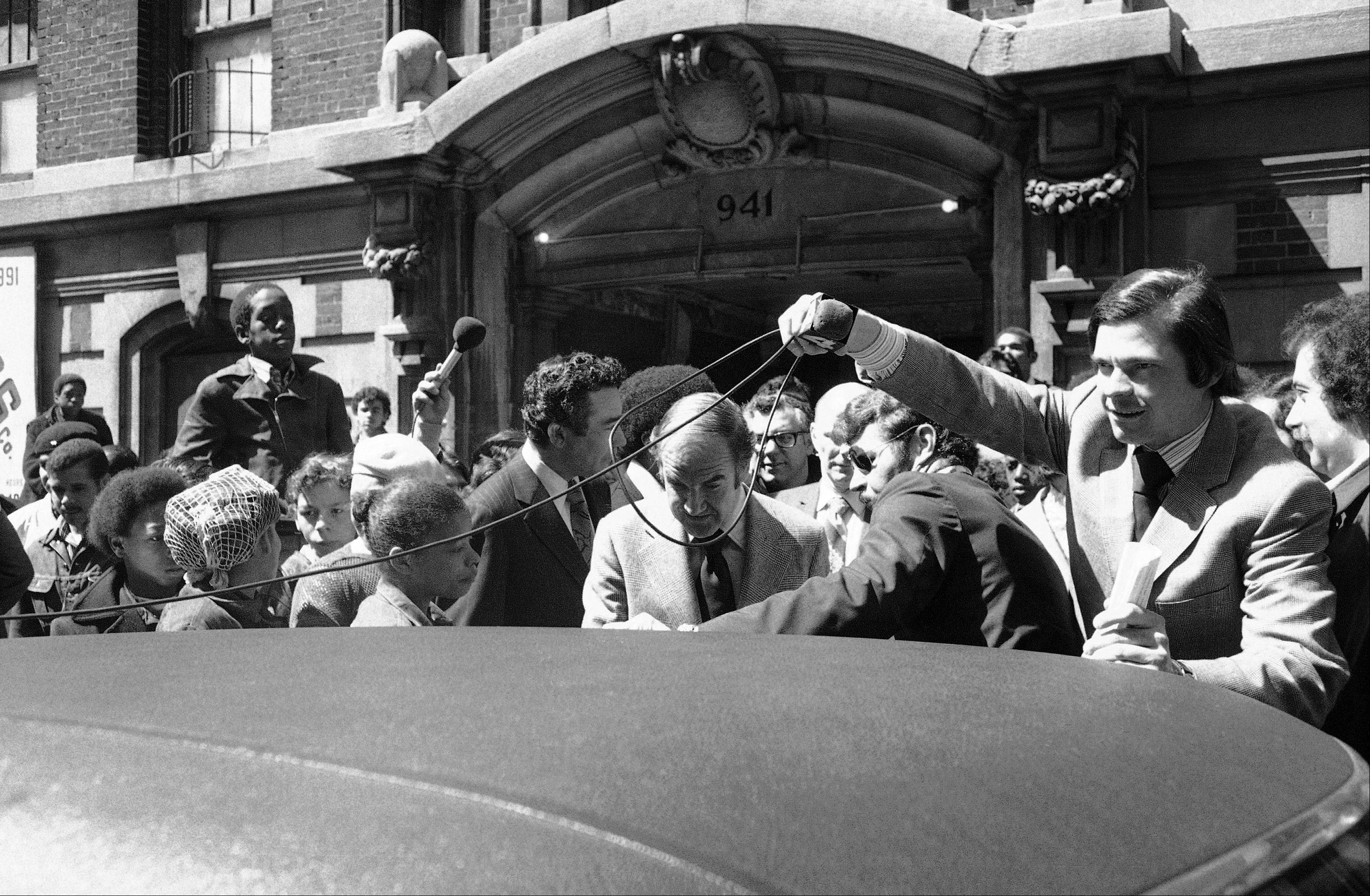 A television microphone cord dangles in front of Sen. George McGovern as the presidential candidate enters car in South Bronx area of New York, April 21, 1972.