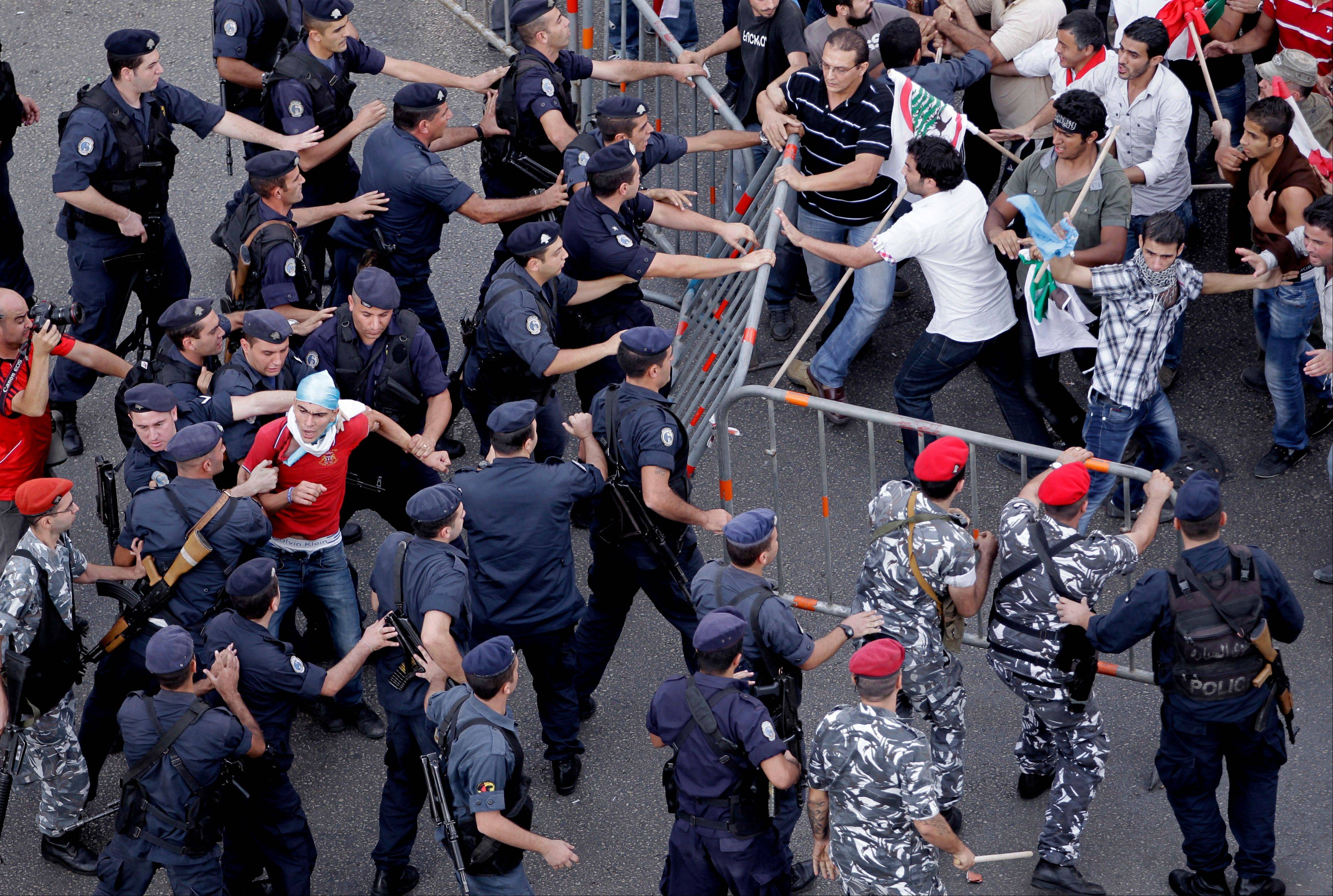 Police and protesters clash Sunday after the funeral of Brig. Gen. Wissam al-Hassan in Beirut, Lebanon.
