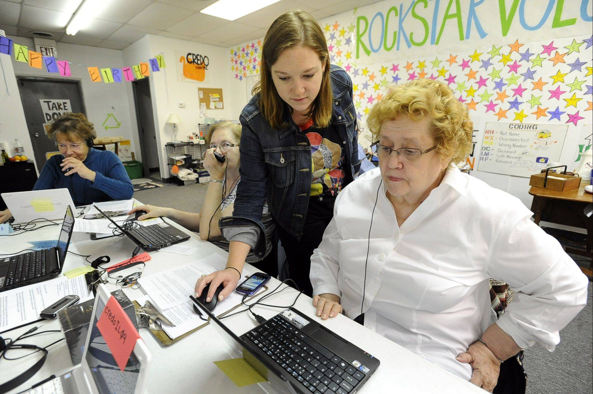 "Katie Cozort, field organizer for CREDO SuperPAC, helps volunteer Ruth Farnham of Hanover Park make political phone calls last week in Elk Grove Village. CREDO is one of several SuperPACs that have dropped into the hotly contested congressional race, but is spending its limited funding on what it describes as a ""grass roots campaign."""