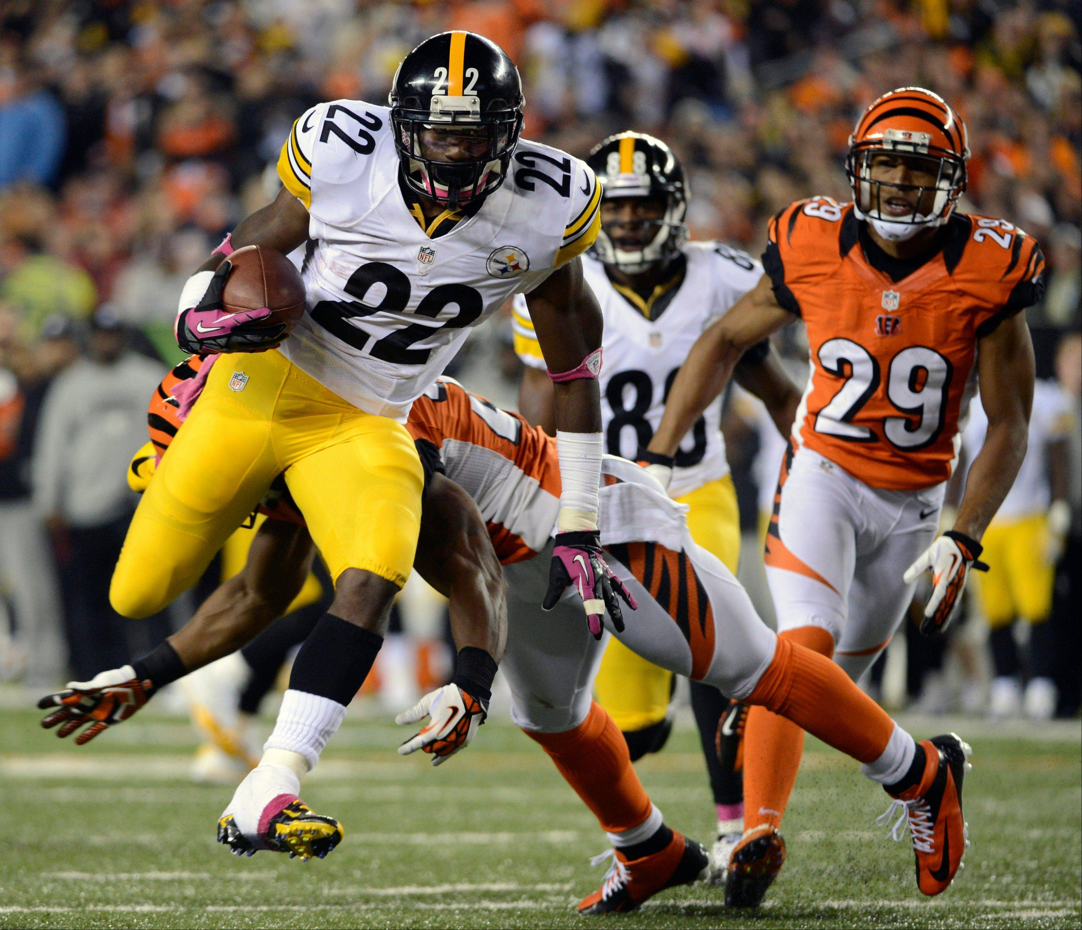 Pittsburgh Steelers running back Chris Rainey runs past Cincinnati Bengals safety Nate Clements to score a touchdown in the second Sunday in Cincinnati.